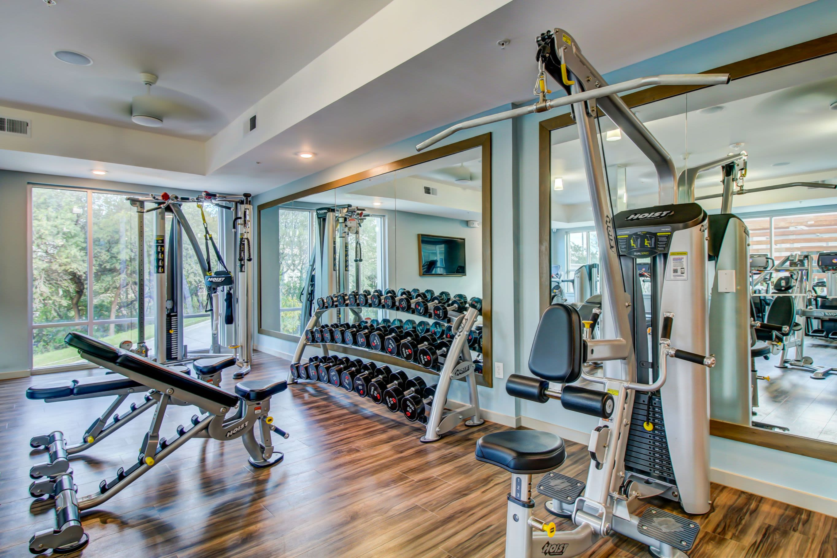 Free weights and machines in the fitness center at Westerly 360 in Austin, Texas