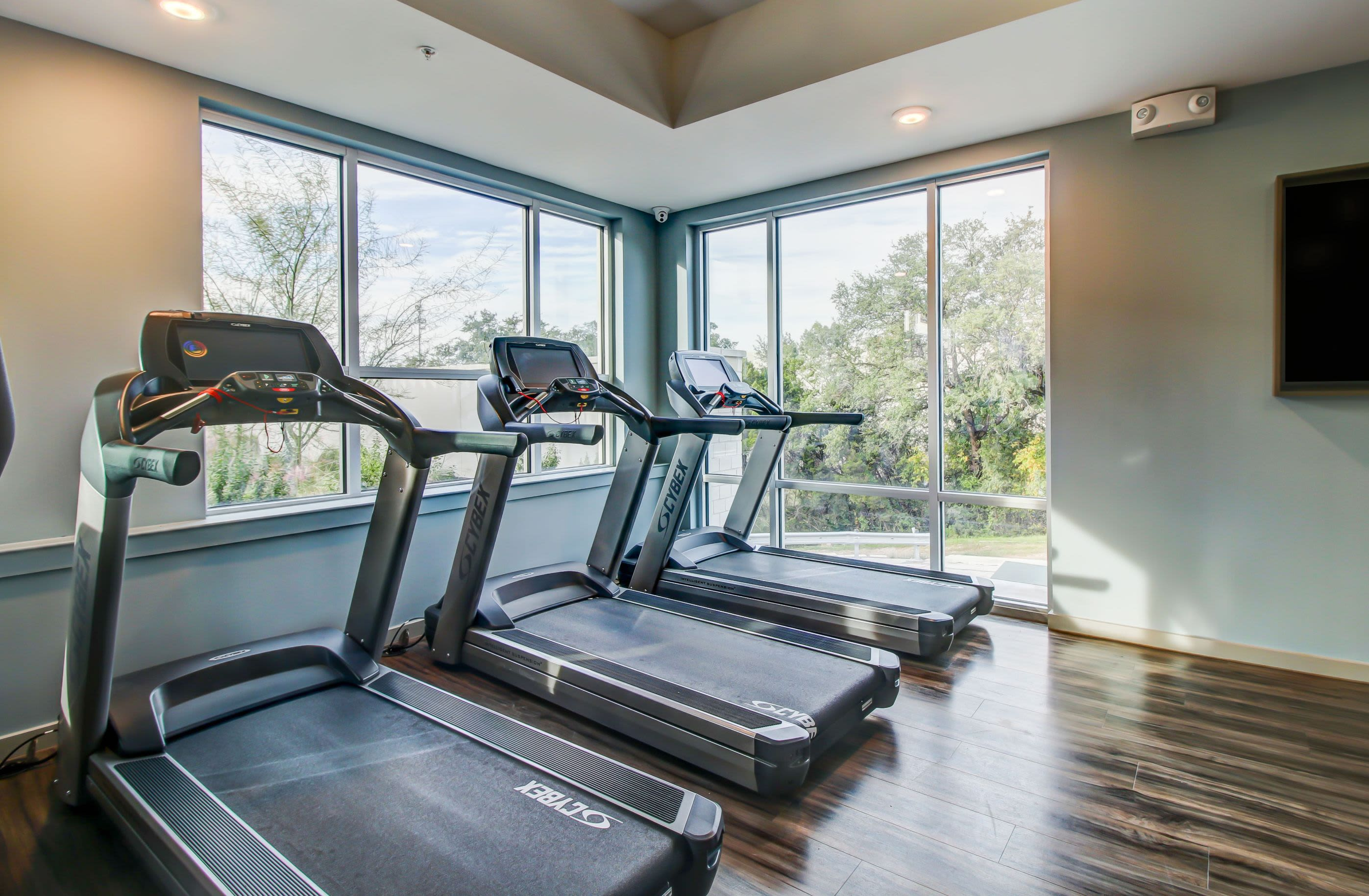 Row of treadmills in the fitness center at Westerly 360 in Austin, Texas