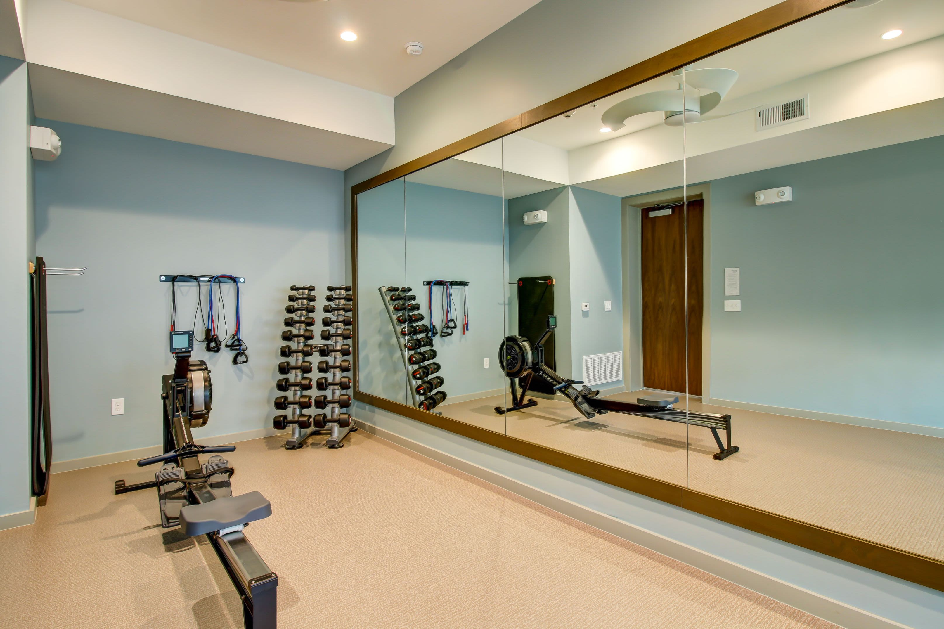 Rowing machine next to floor to ceiling windows at Westerly 360 in Austin, Texas