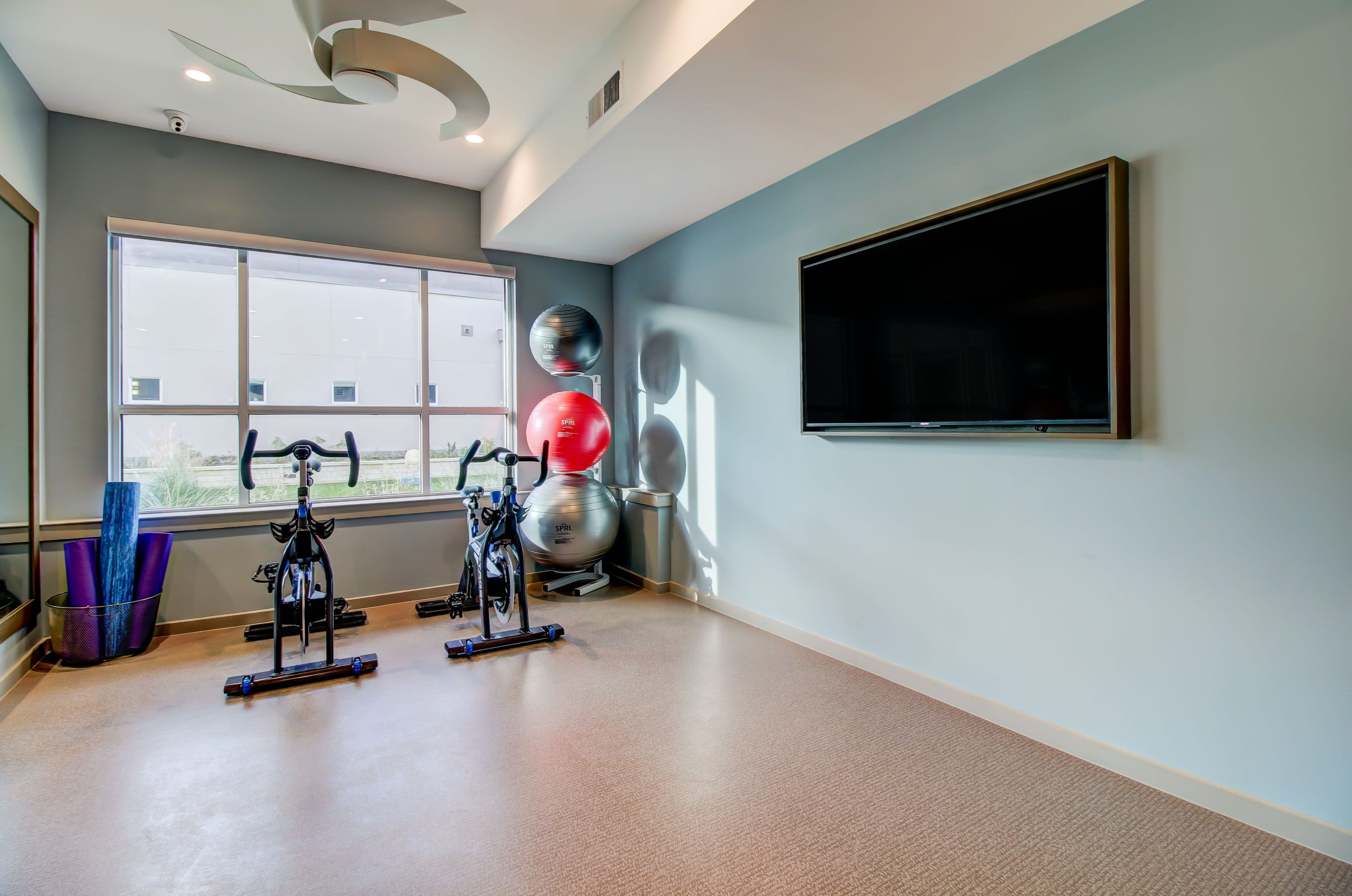 Spin cycle room with a large TV at Westerly 360 in Austin, Texas