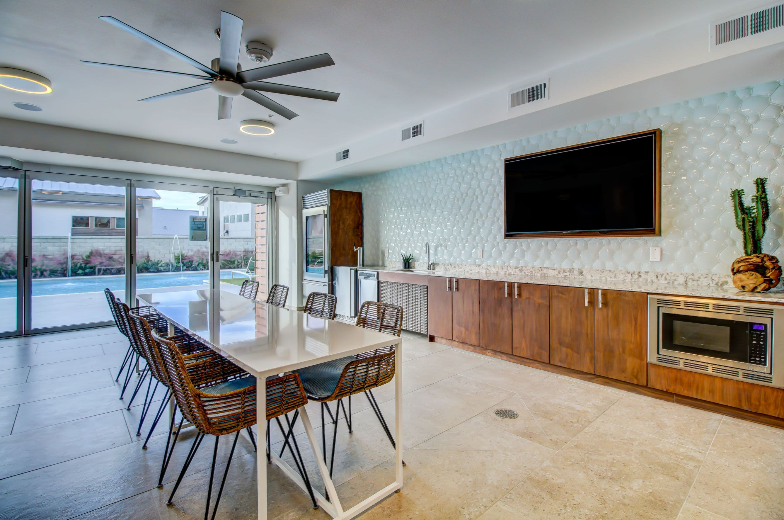 Community clubhouse with a large TV at Westerly 360 in Austin, Texas