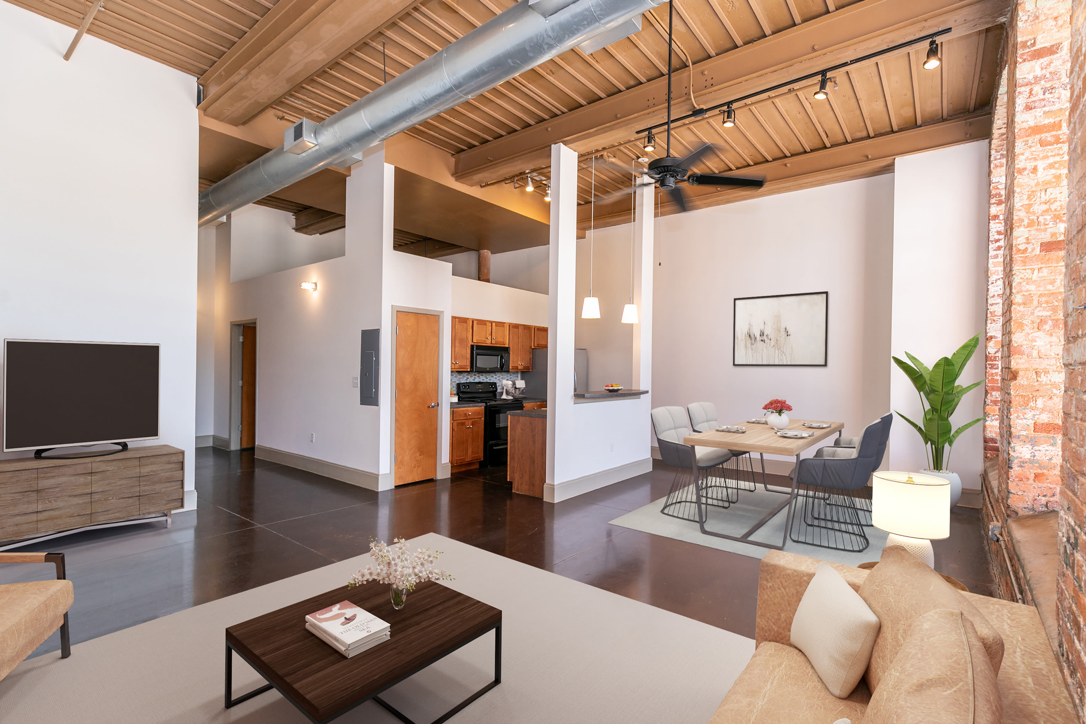 Open living room and kitchen at Porterdale Mill Lofts in Porterdale, Georgia