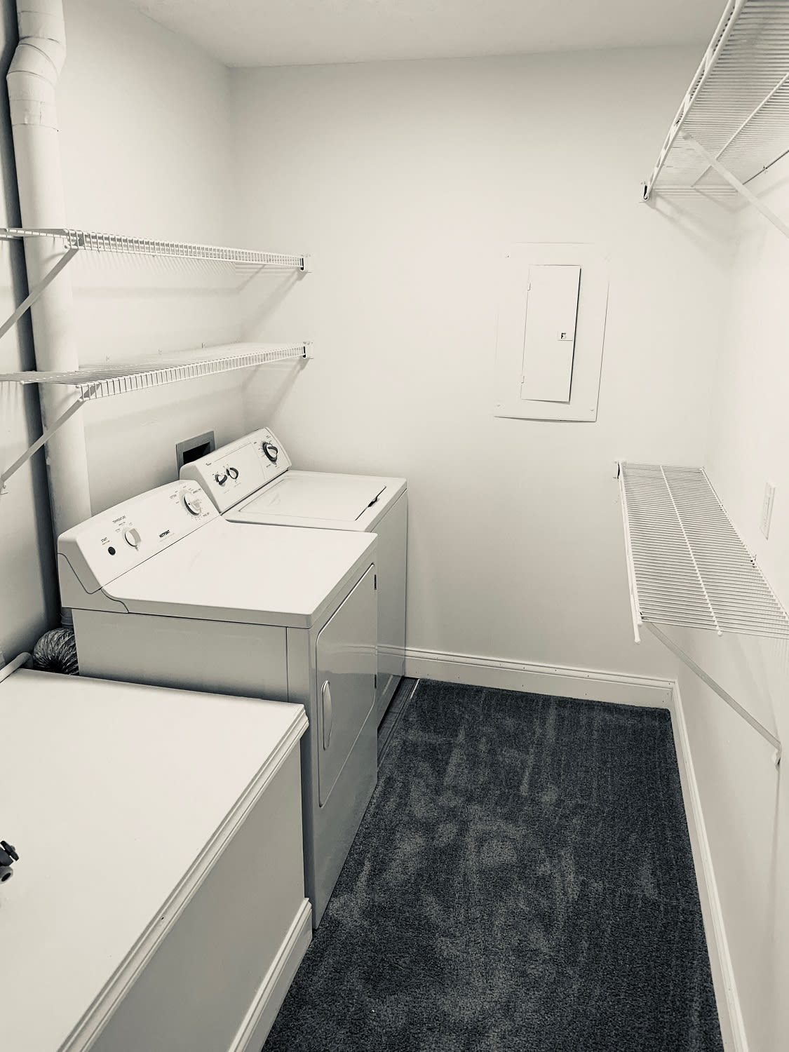 Walk-in closet with washer and dryer at Brittany Bay Apartments and Townhomes in Groveport, Ohio