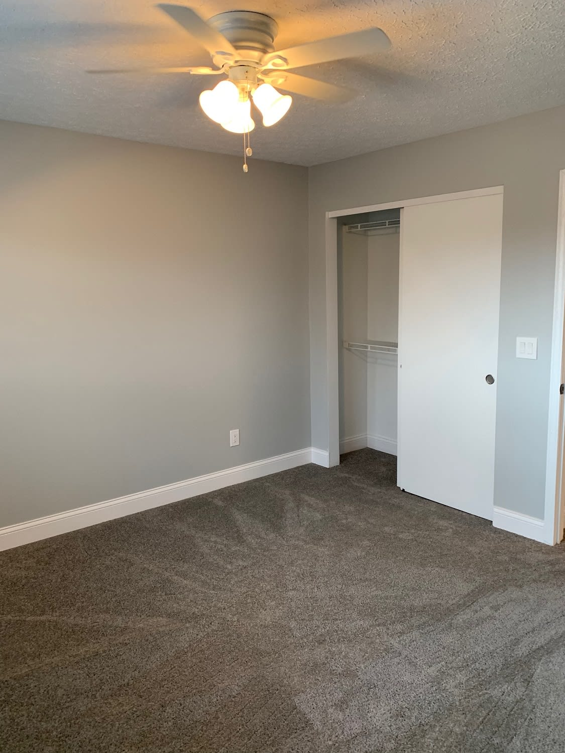 Model bedroom at Brittany Bay Apartments and Townhomes in Groveport, Ohio