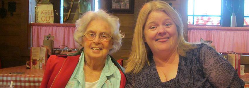 Caretaker and resident out to a restaurant at Avalon Assisted Living Community in Fitchburg, Wisconsin