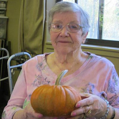 Woman with a pumpkin at Avalon Assisted Living Community in Fitchburg, Wisconsin