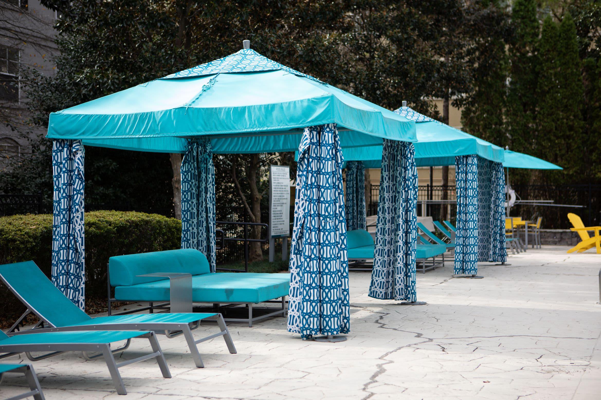Covered poolside seating at Marq Perimeter in Atlanta, Georgia