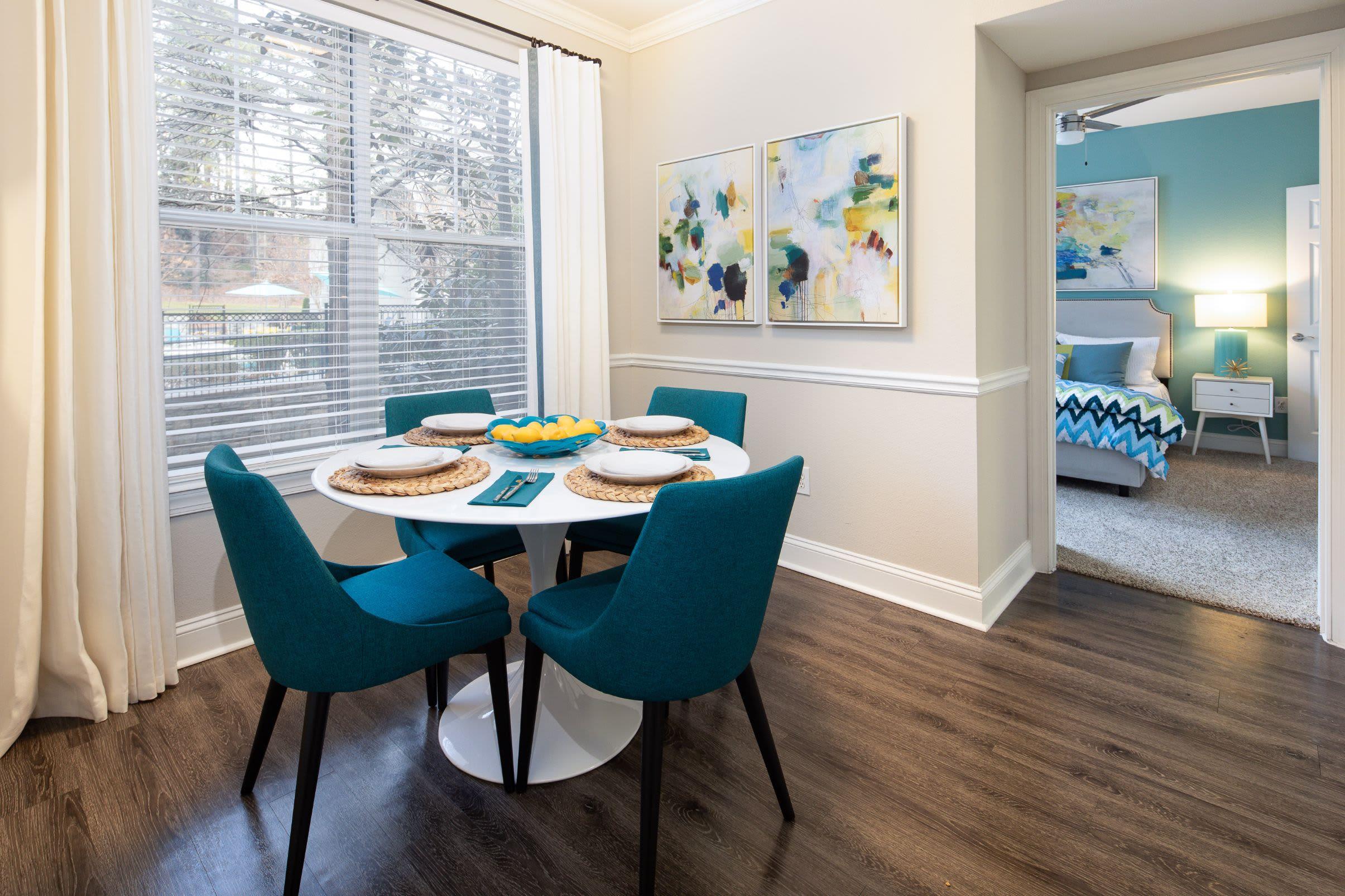 Bright dining area with wood floors at Marq Perimeter in Atlanta, Georgia