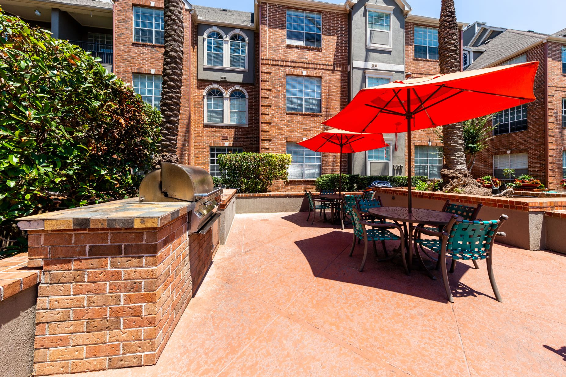 Patio with seating and gas grills at Marquis on Pin Oak in Houston, Texas