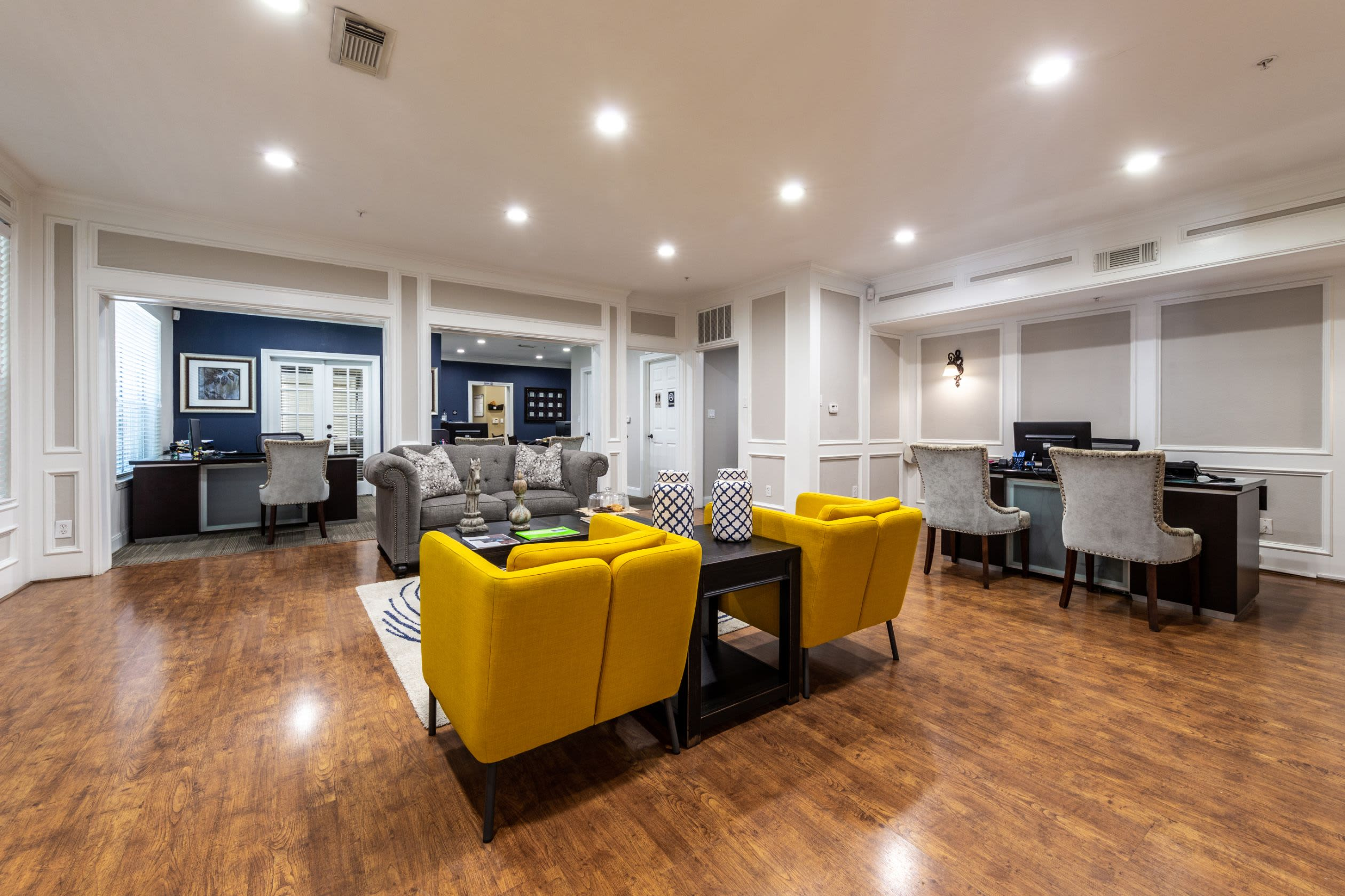 Spacious clubhouse with wood floors at Marquis on Pin Oak in Houston, Texas
