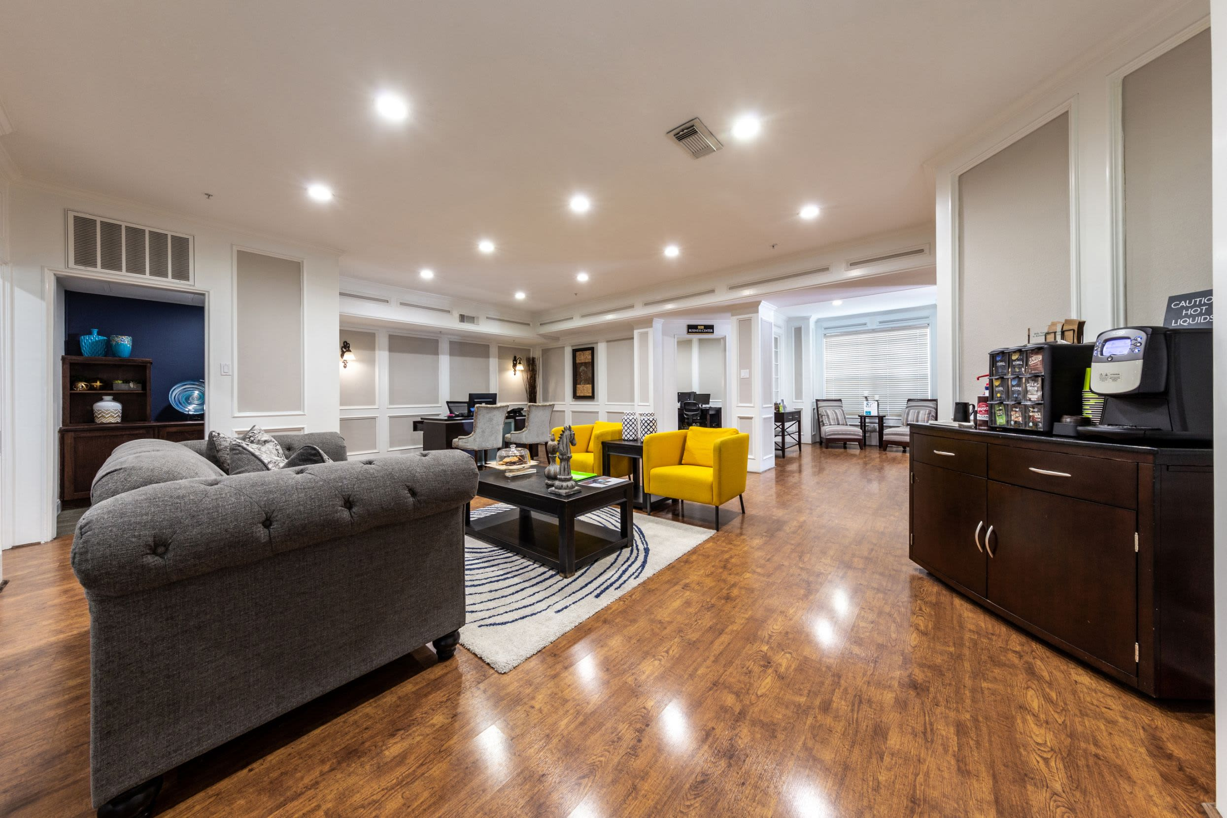 Community clubhouse with multiple couches at Marquis on Pin Oak in Houston, Texas