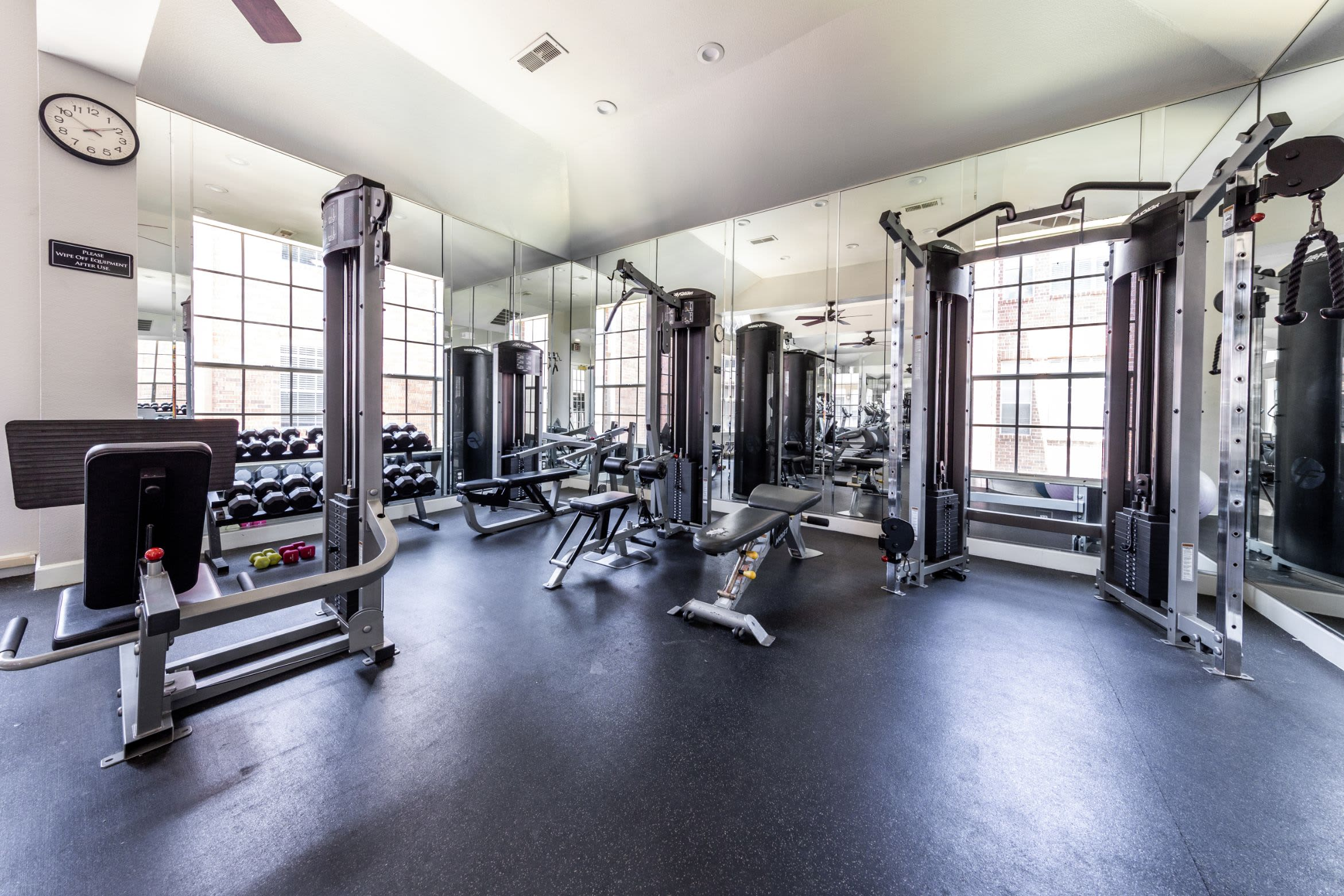 Free weights and cable machines in the fitness center at Marquis on Pin Oak in Houston, Texas