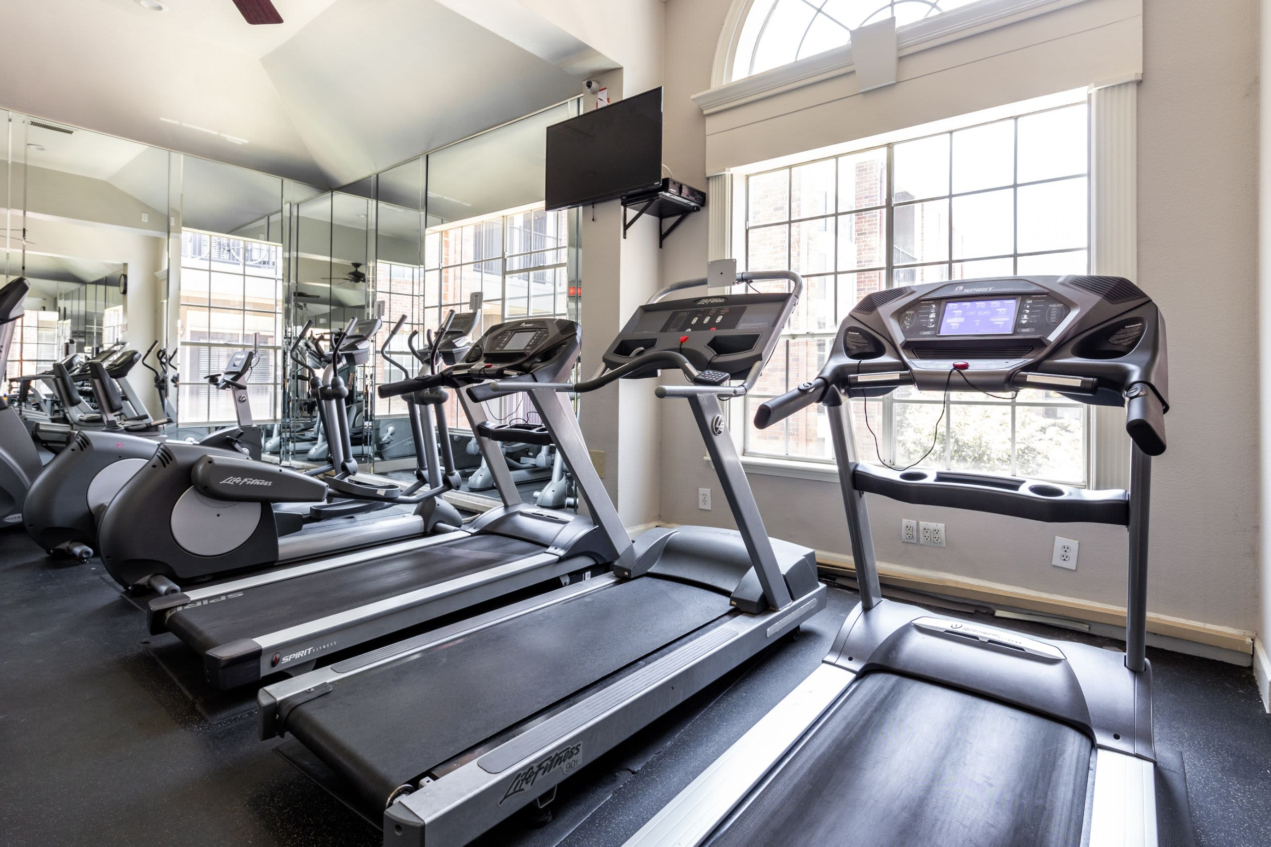 Row of cardio machines in the fitness center at Marquis on Pin Oak in Houston, Texas