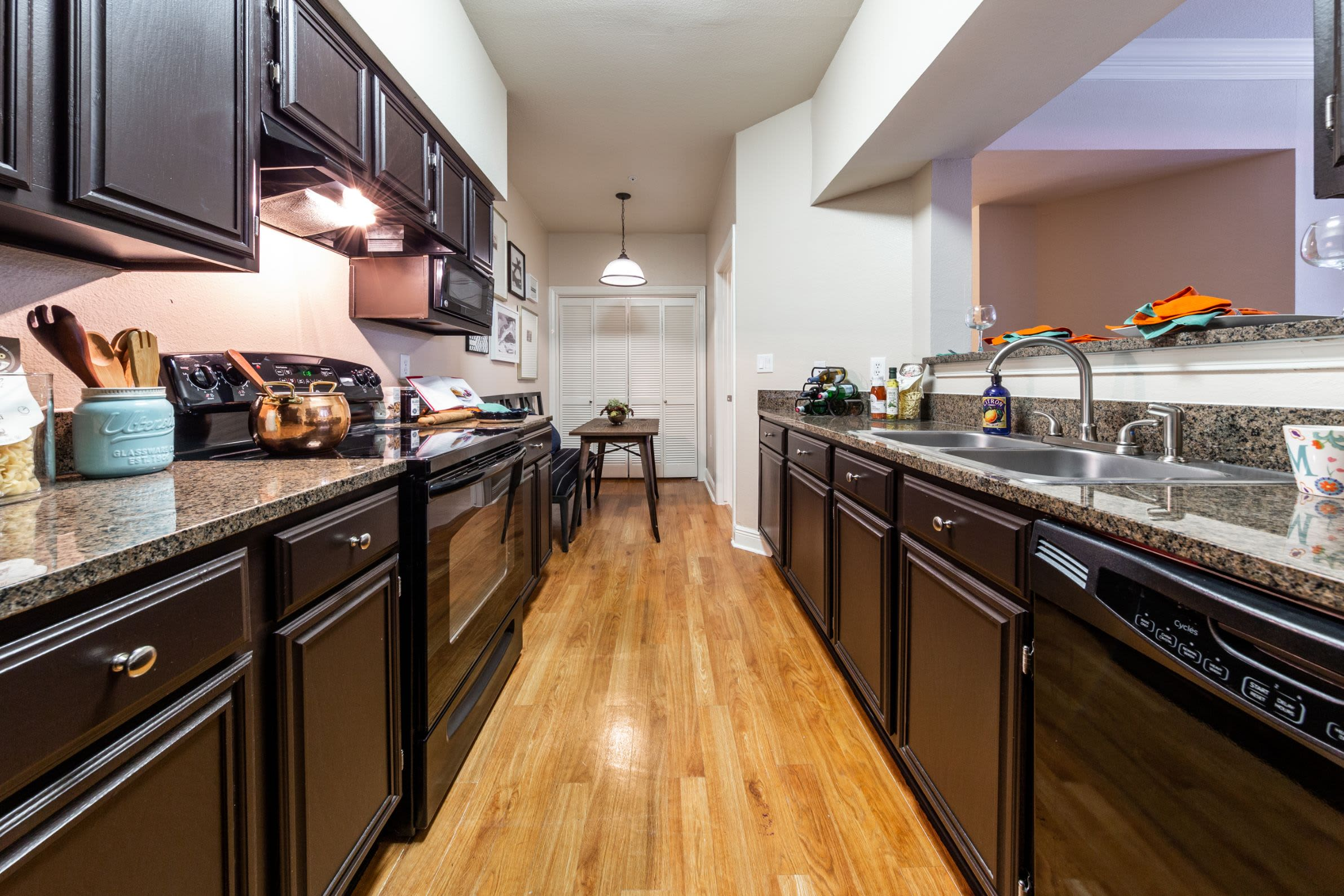 Kitchen with black appliances at Marquis on Pin Oak in Houston, Texas