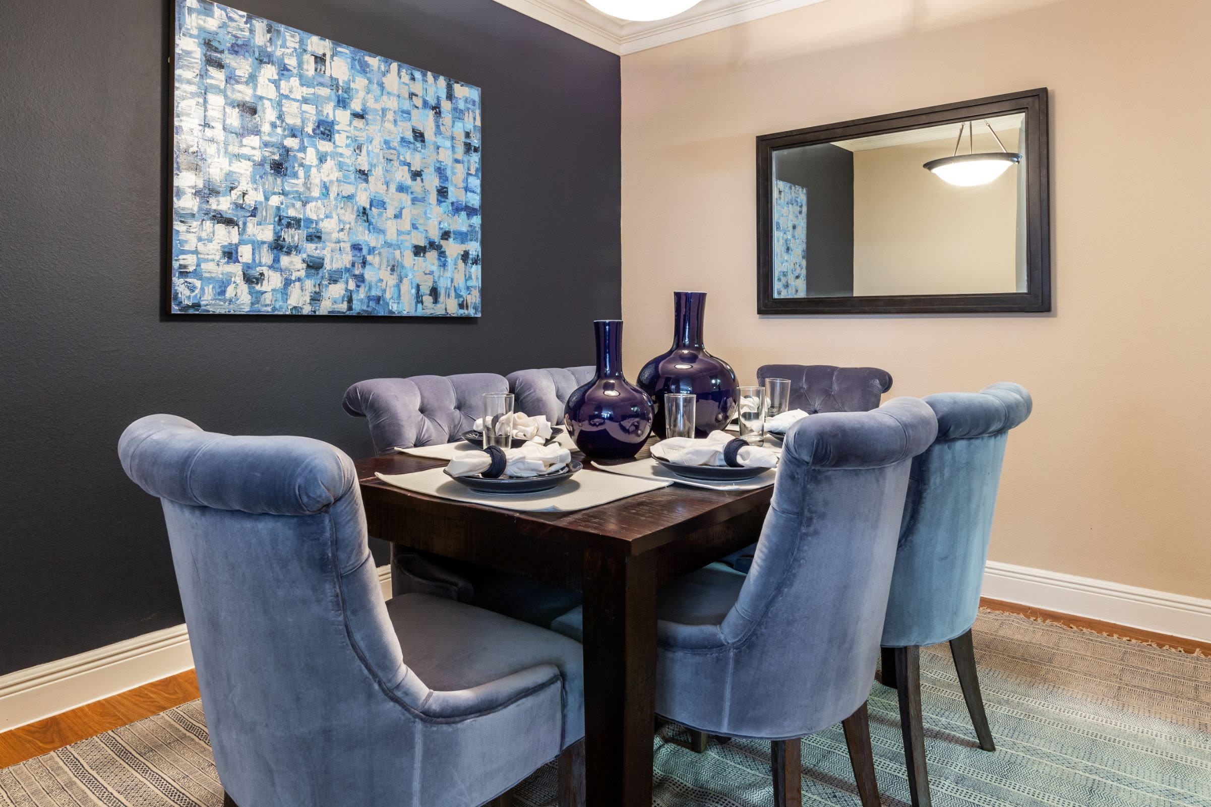 Dining room with a navy colored accent wall at Marquis on Pin Oak in Houston, Texas