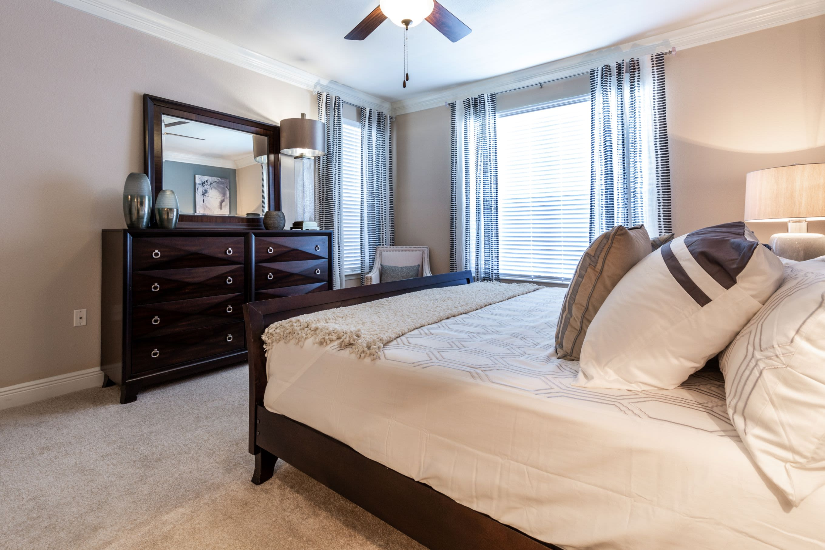 Spacious bedroom with carpet floors at Marquis on Pin Oak in Houston, Texas