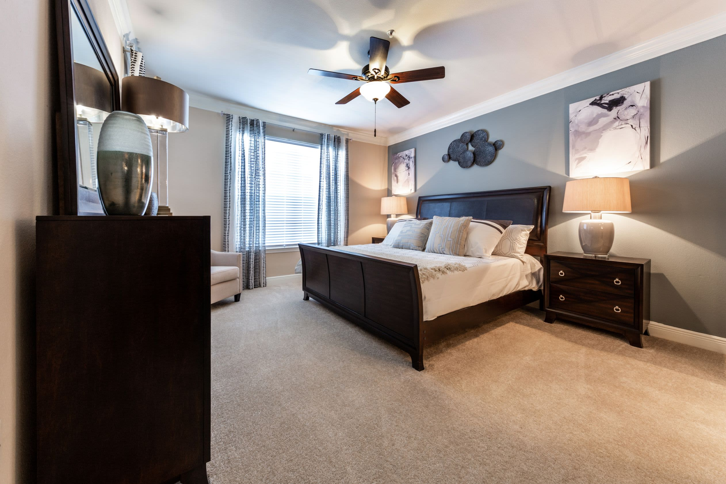 Bright bedroom with a ceiling fan at Marquis on Pin Oak in Houston, Texas