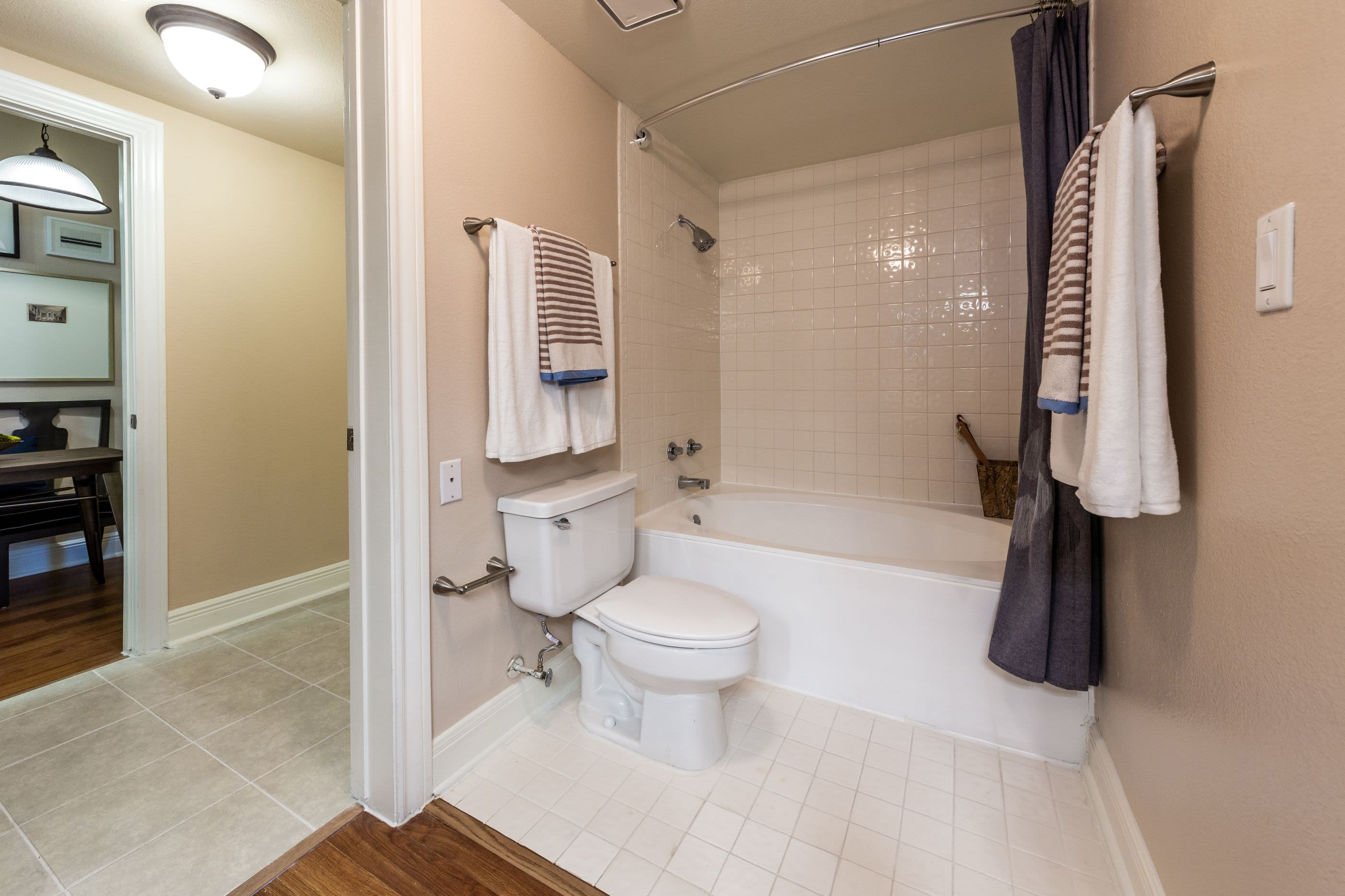 Bathroom with a tub and a shower at Marquis on Pin Oak in Houston, Texas