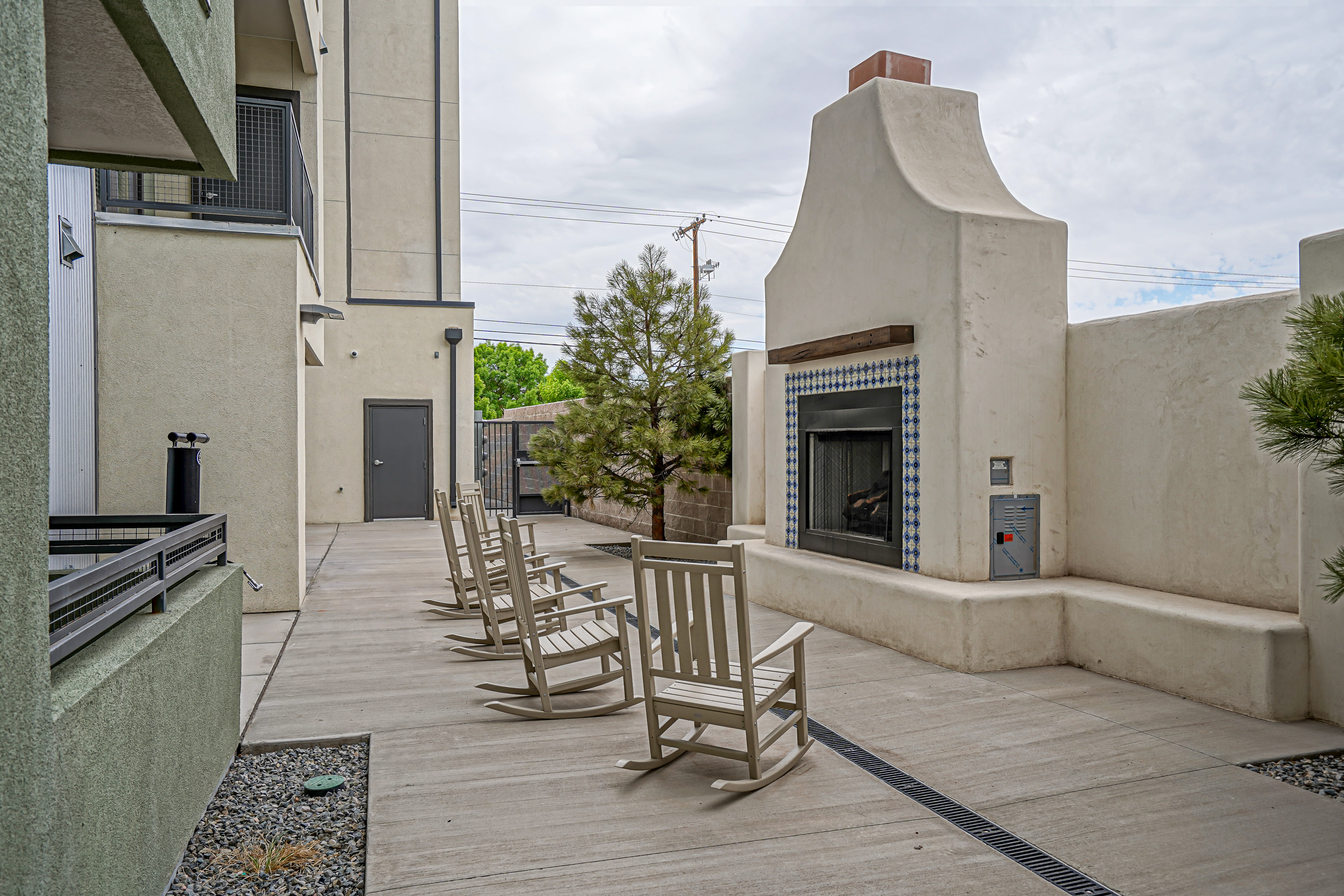 Outdoor patio seating with a fireplace at Capitol Flats in Santa Fe, New Mexico