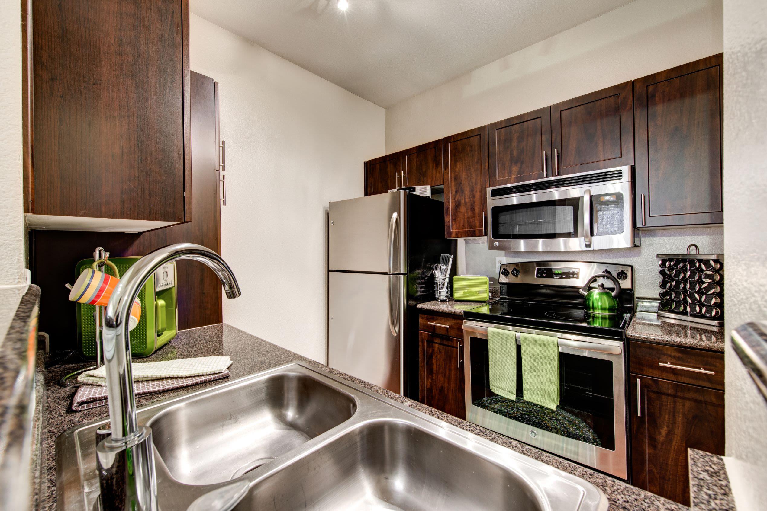 Kitchen with dark brown cabinets at Marquis on Gaston in Dallas, Texas