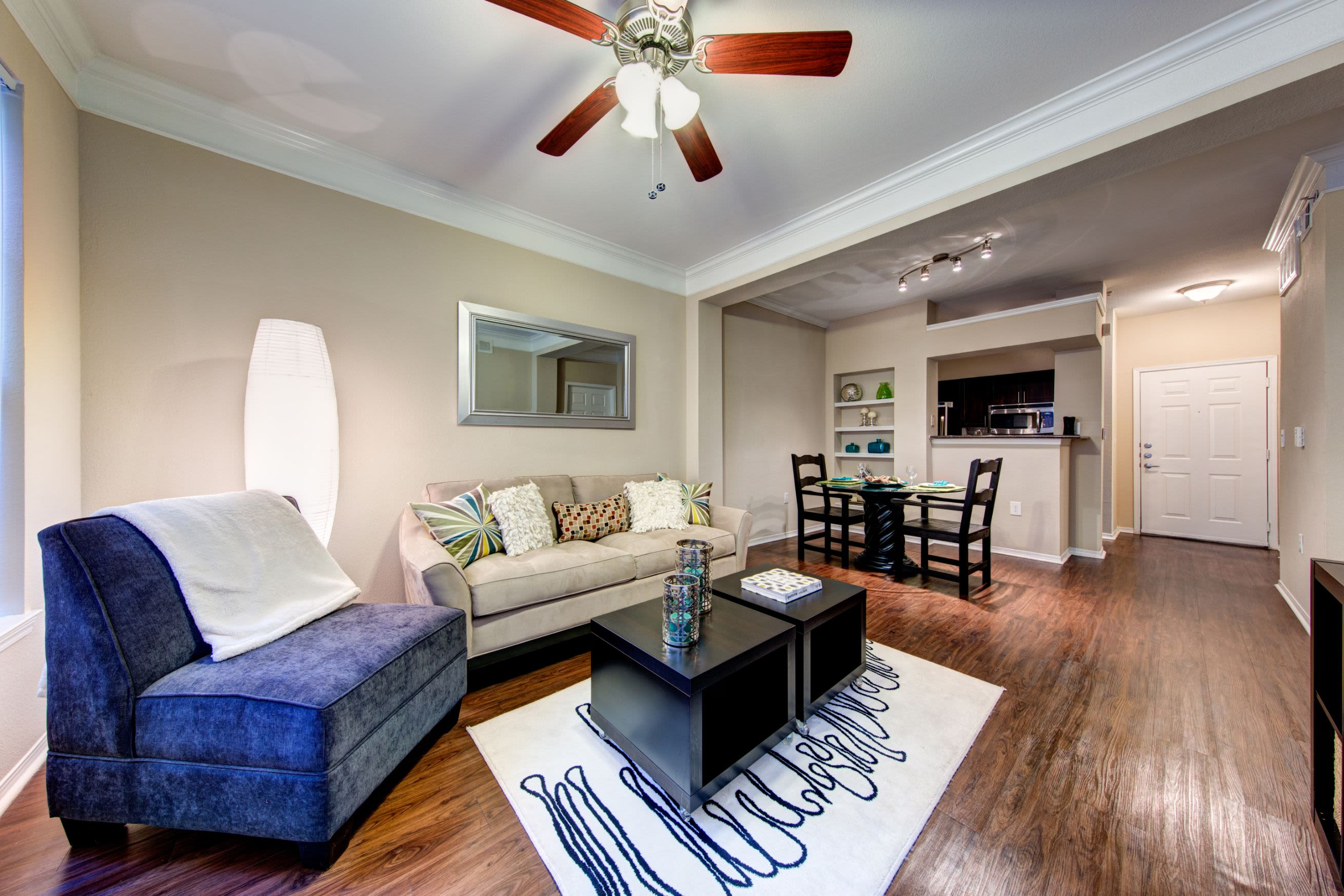 Bright living room with a ceiling fan at Marquis on Gaston in Dallas, Texas