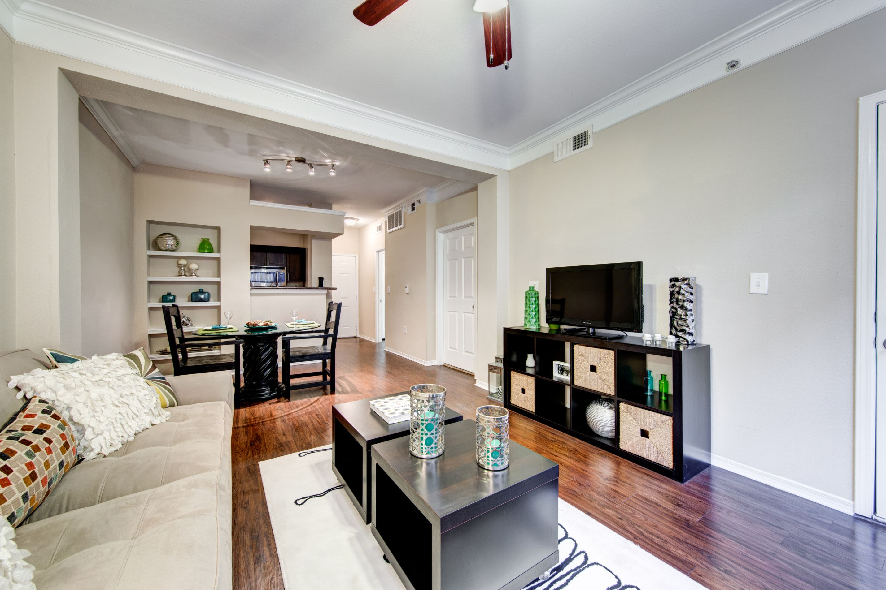 Bright living room with wood style floors at Marquis on Gaston in Dallas, Texas