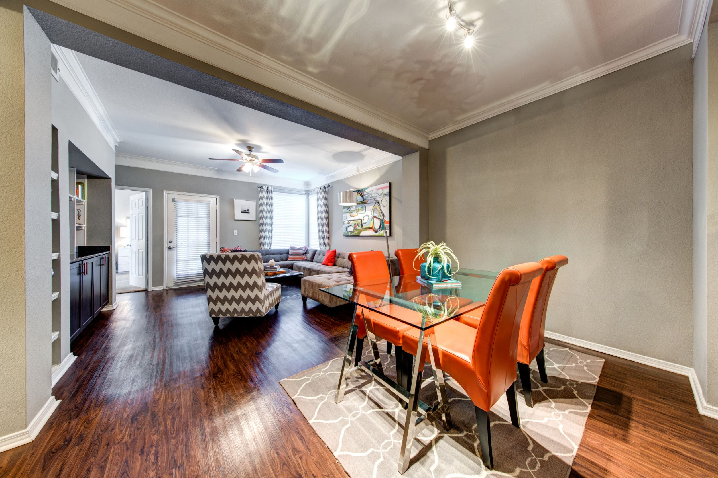Dining room with wood floors and a rug under the table at Marquis on Gaston in Dallas, Texas