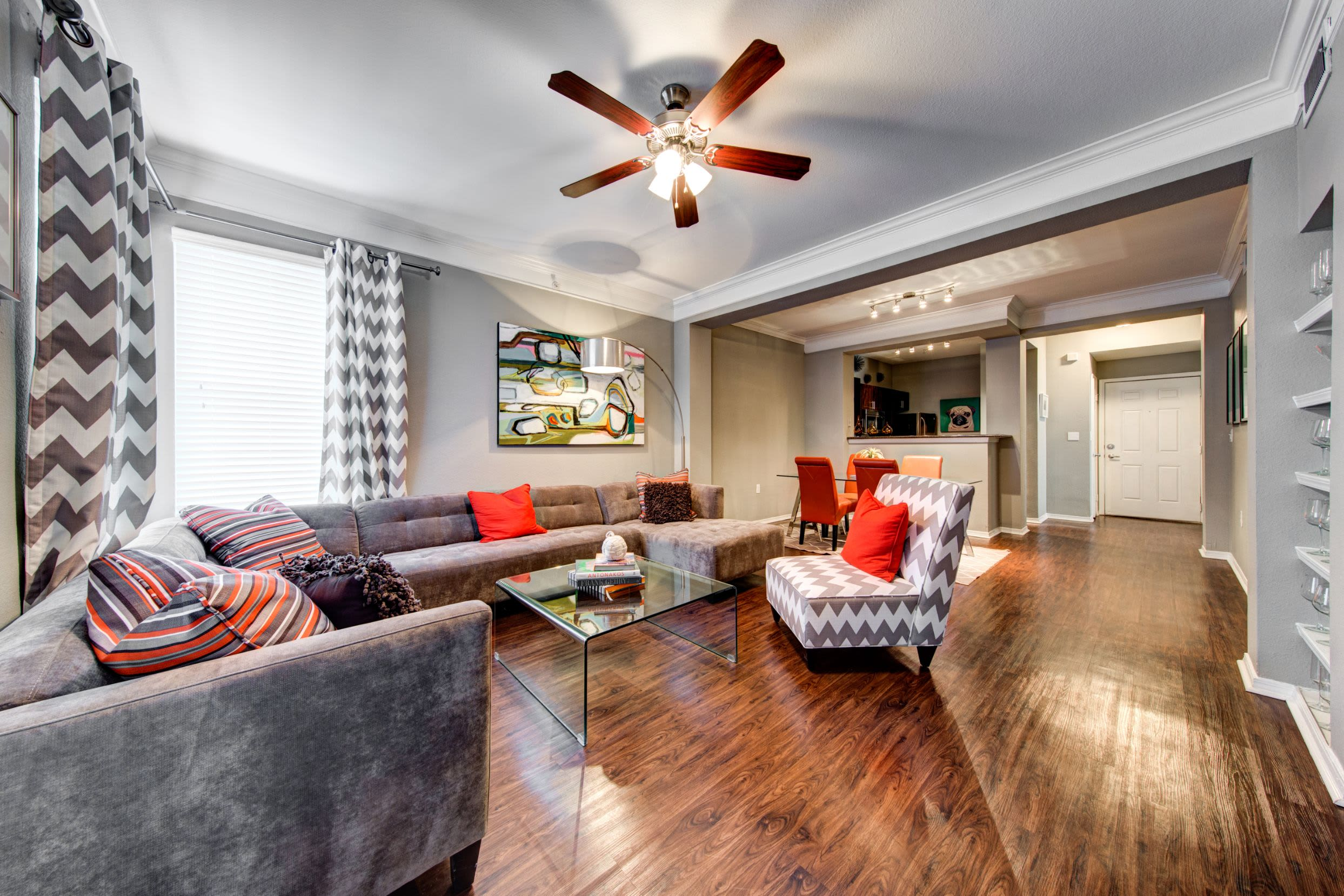 Open living room with a sectional couch at Marquis on Gaston in Dallas, Texas