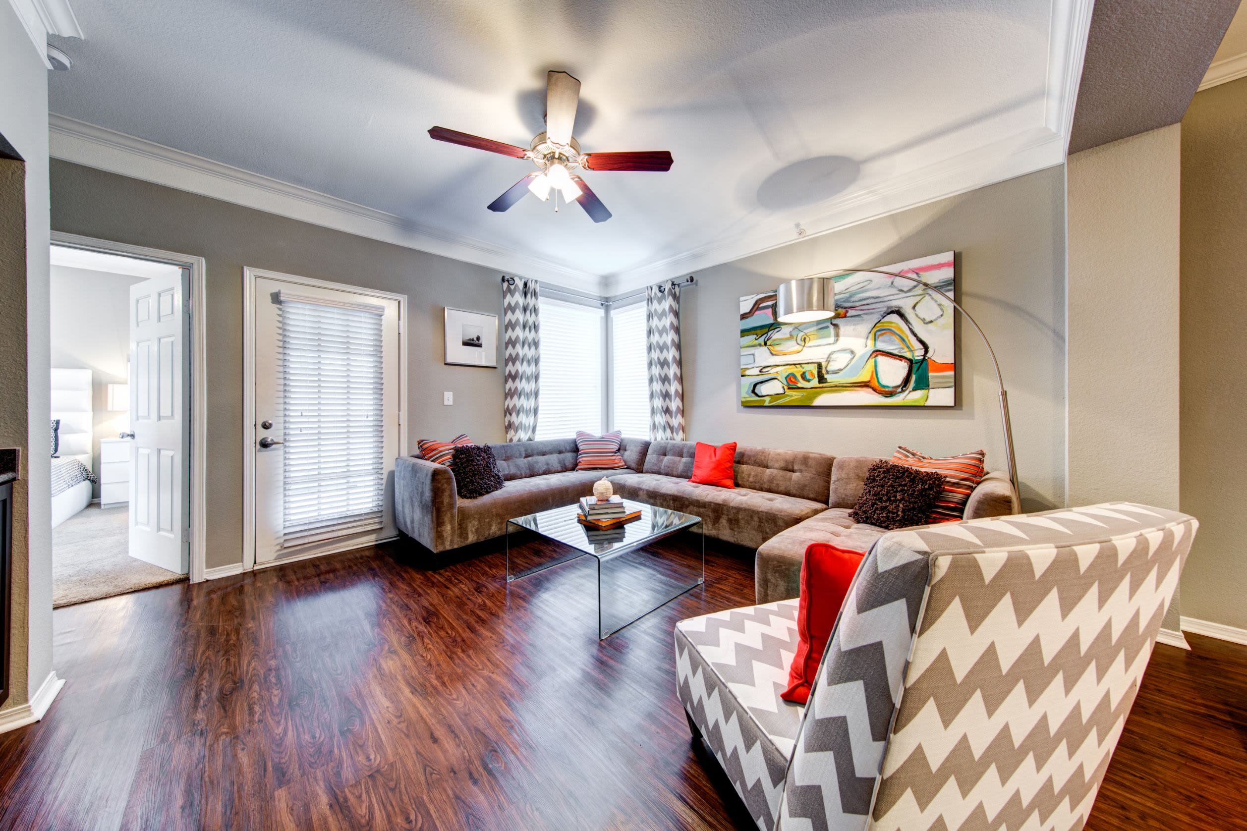 Living room with wood floors and a door leading outside at Marquis on Gaston in Dallas, Texas