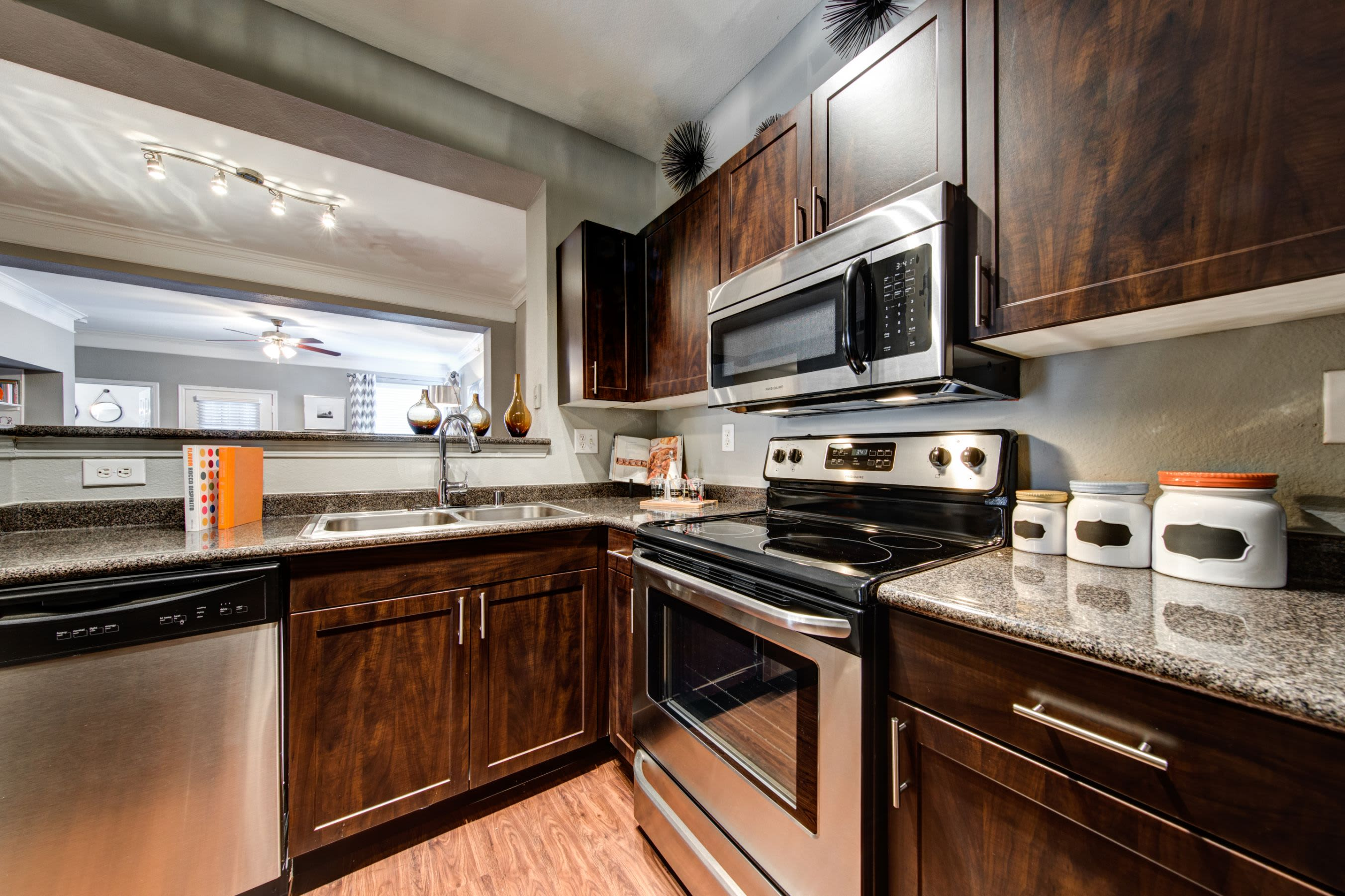 Kitchen with granite style countertops at Marquis on Gaston in Dallas, Texas