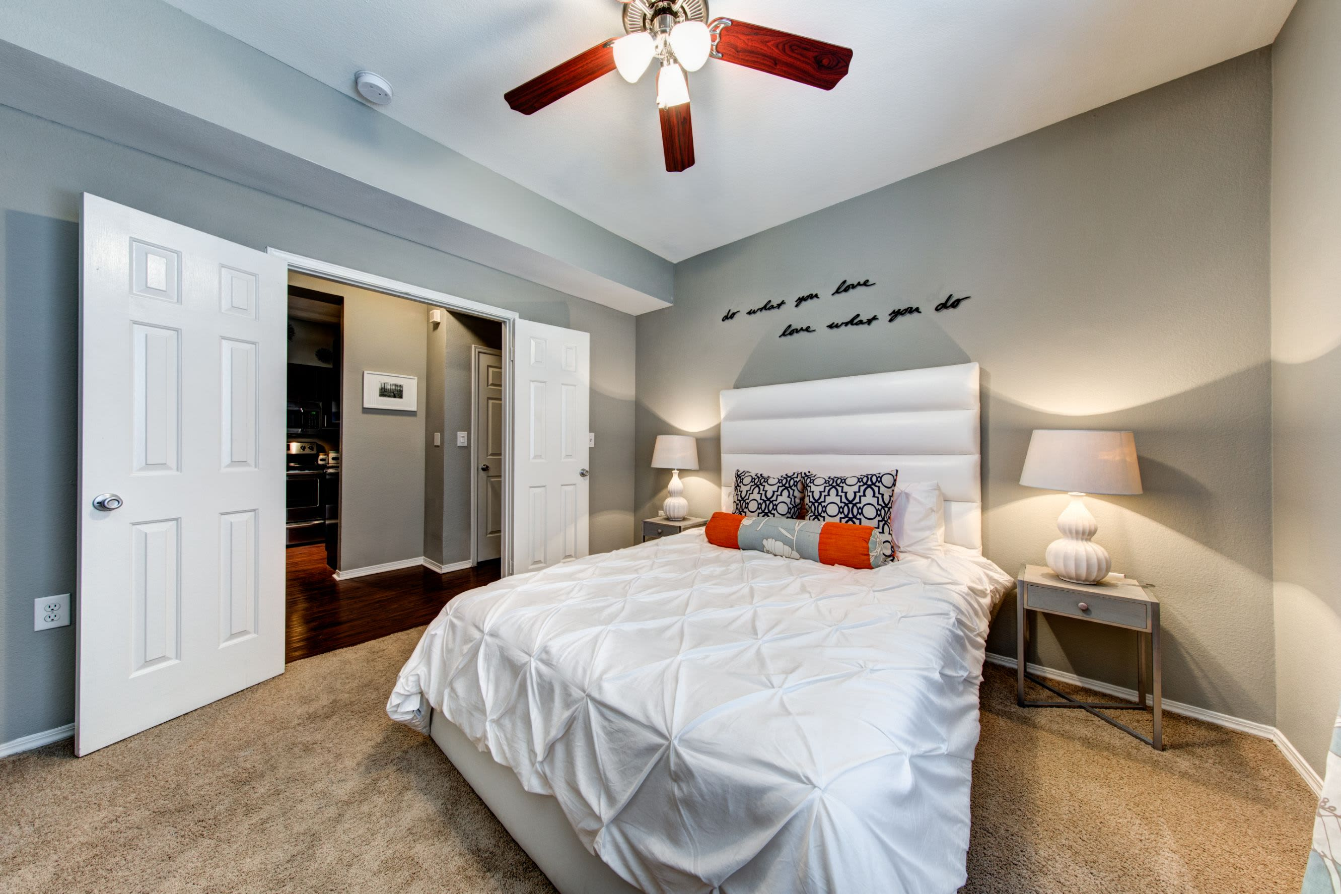 Bedroom with carpet floors and a ceiling fan at Marquis on Gaston in Dallas, Texas
