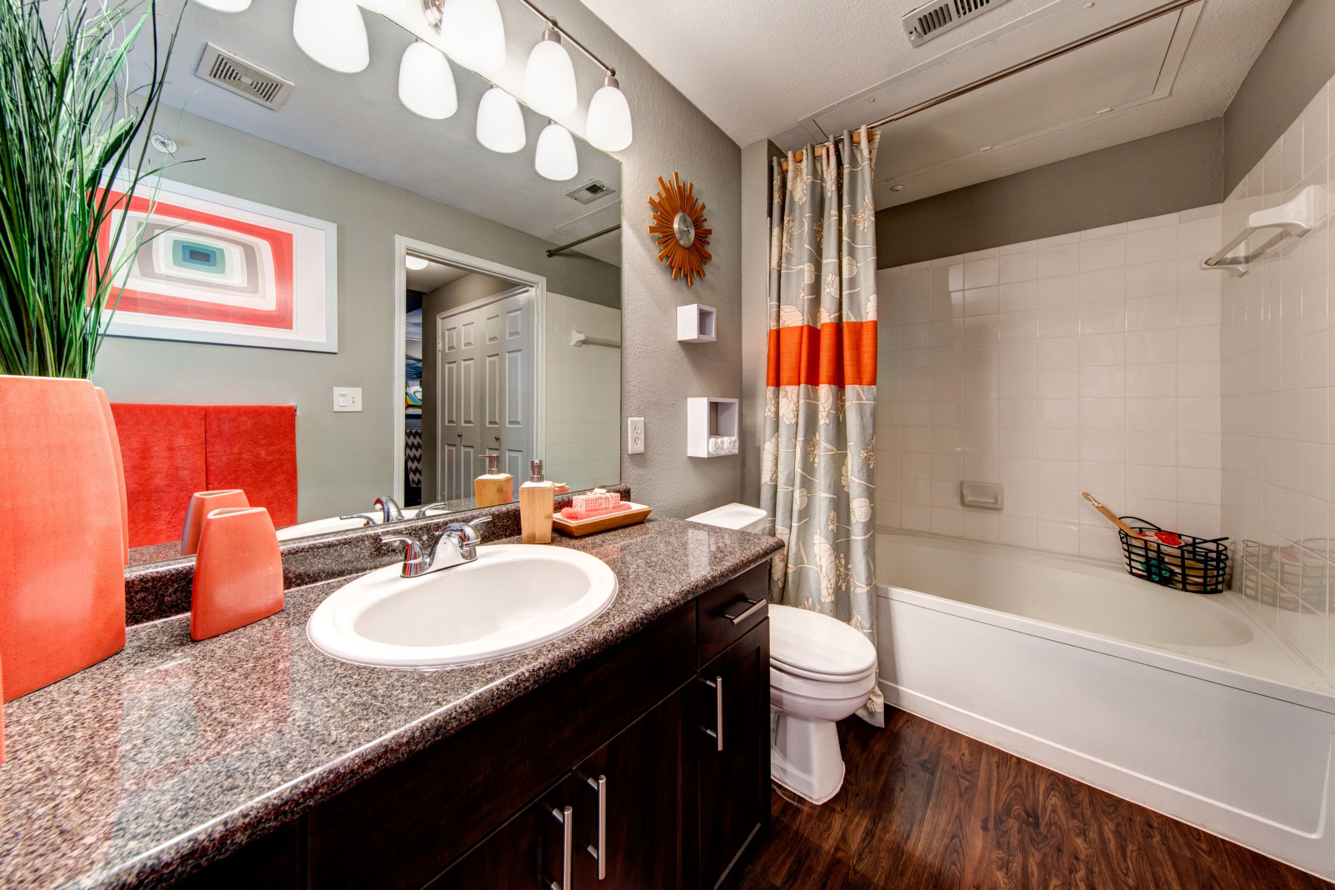 Bathroom with granite style counters at Marquis on Gaston in Dallas, Texas
