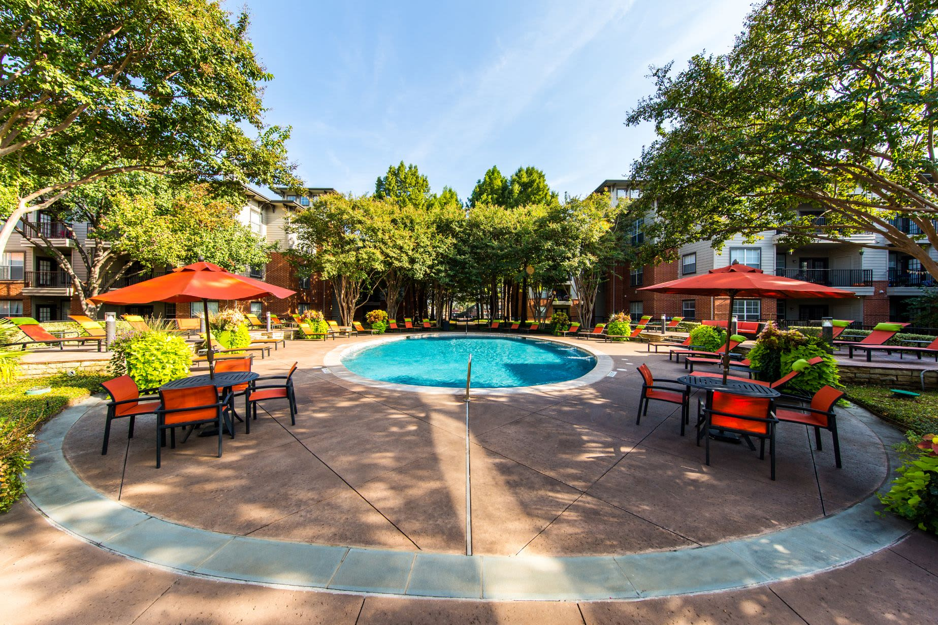 Sparkling pool surrounded by a red brick deck at Marquis on Gaston in Dallas, Texas