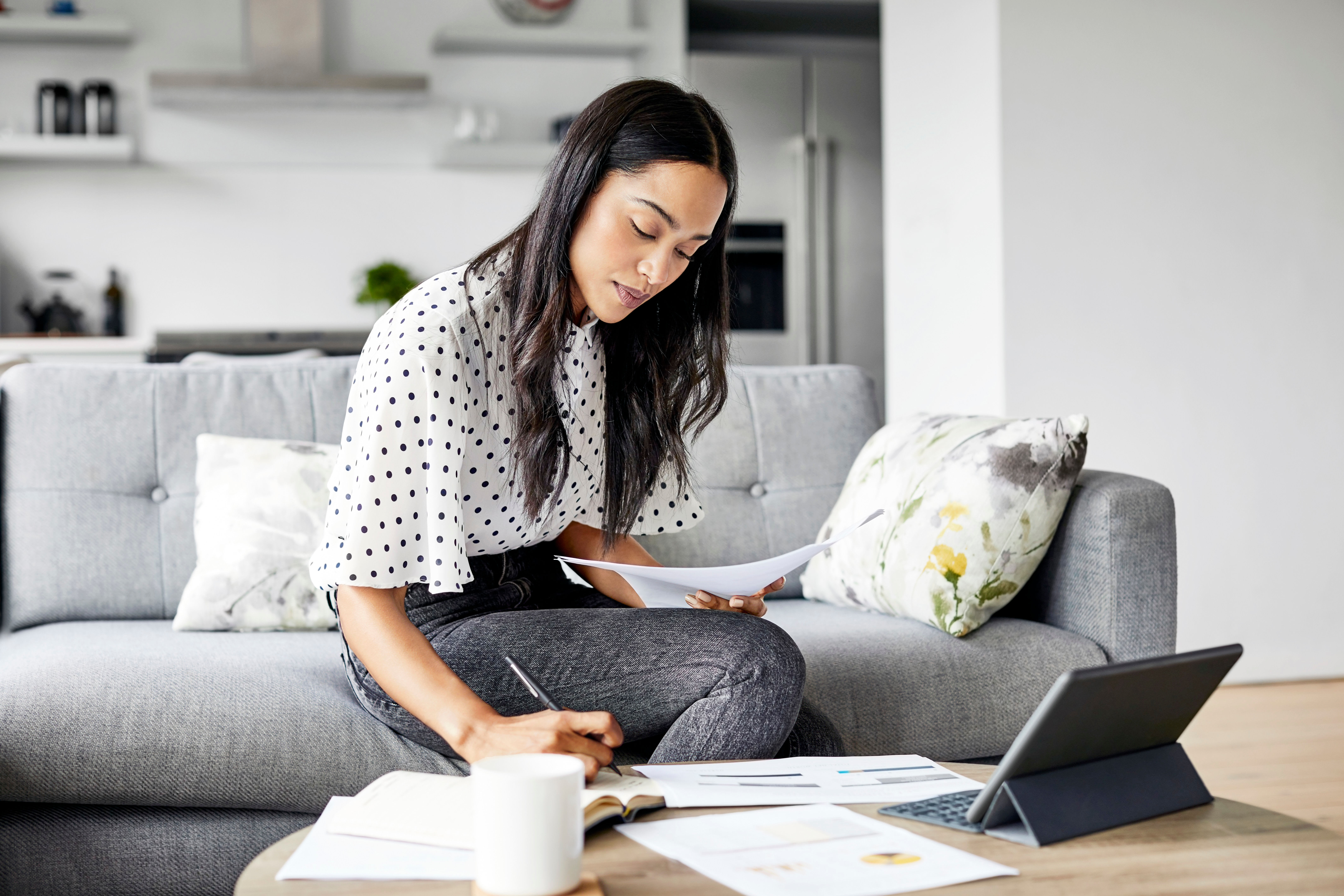 Woman working from home at The Residences at Sawmill Station in Morton Grove, Illinois