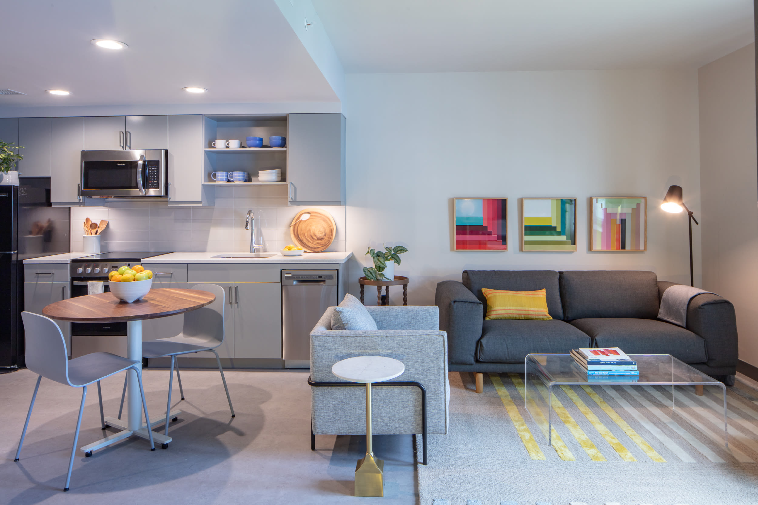 Open-concept model home's well-furnished living area at Thirteen15 in New Orleans, Louisiana