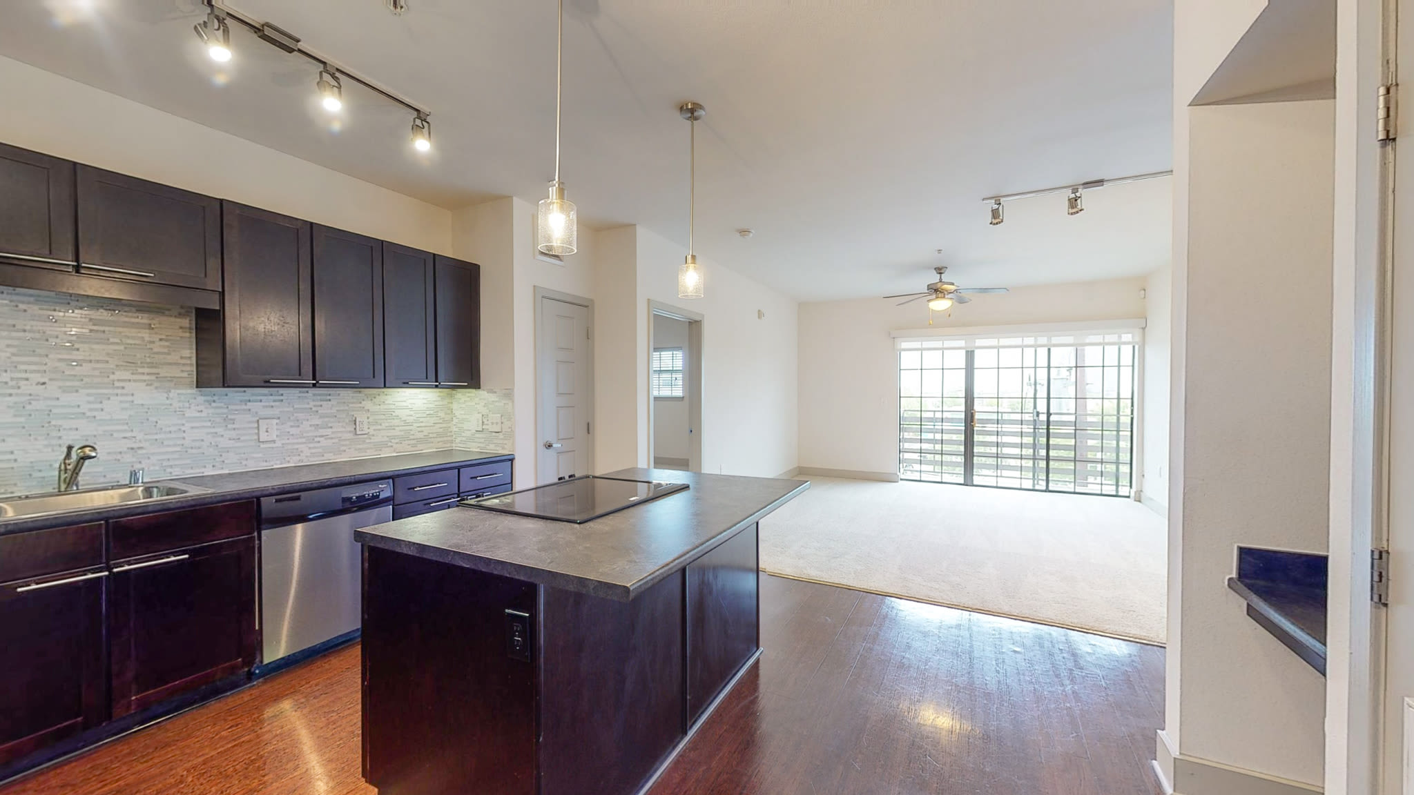 steel appliance kitchen with wood floors at Bellrock Bishop Arts in Dallas, Texas