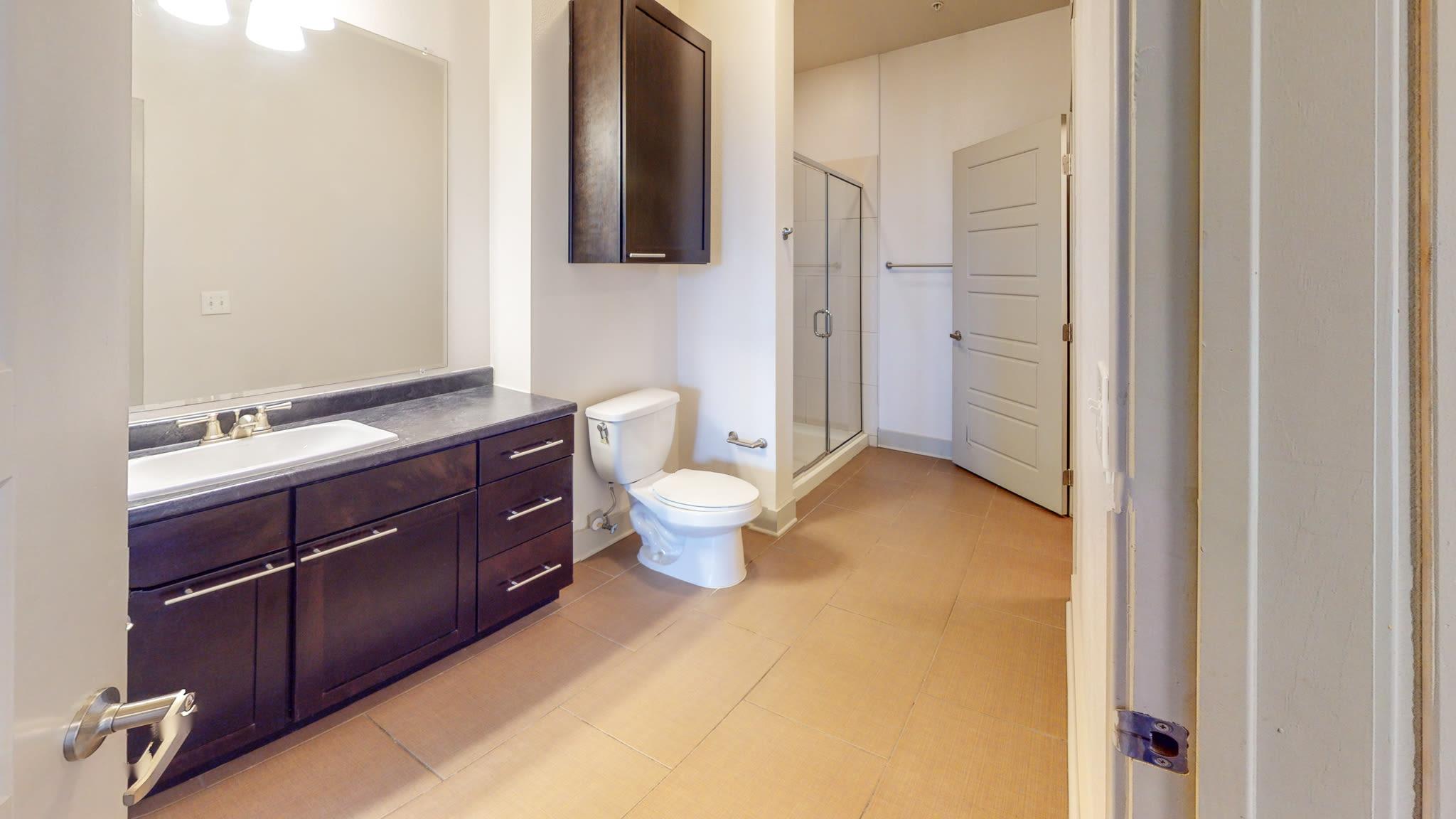 bathroom with dark finishes at Bellrock Bishop Arts in Dallas, Texas