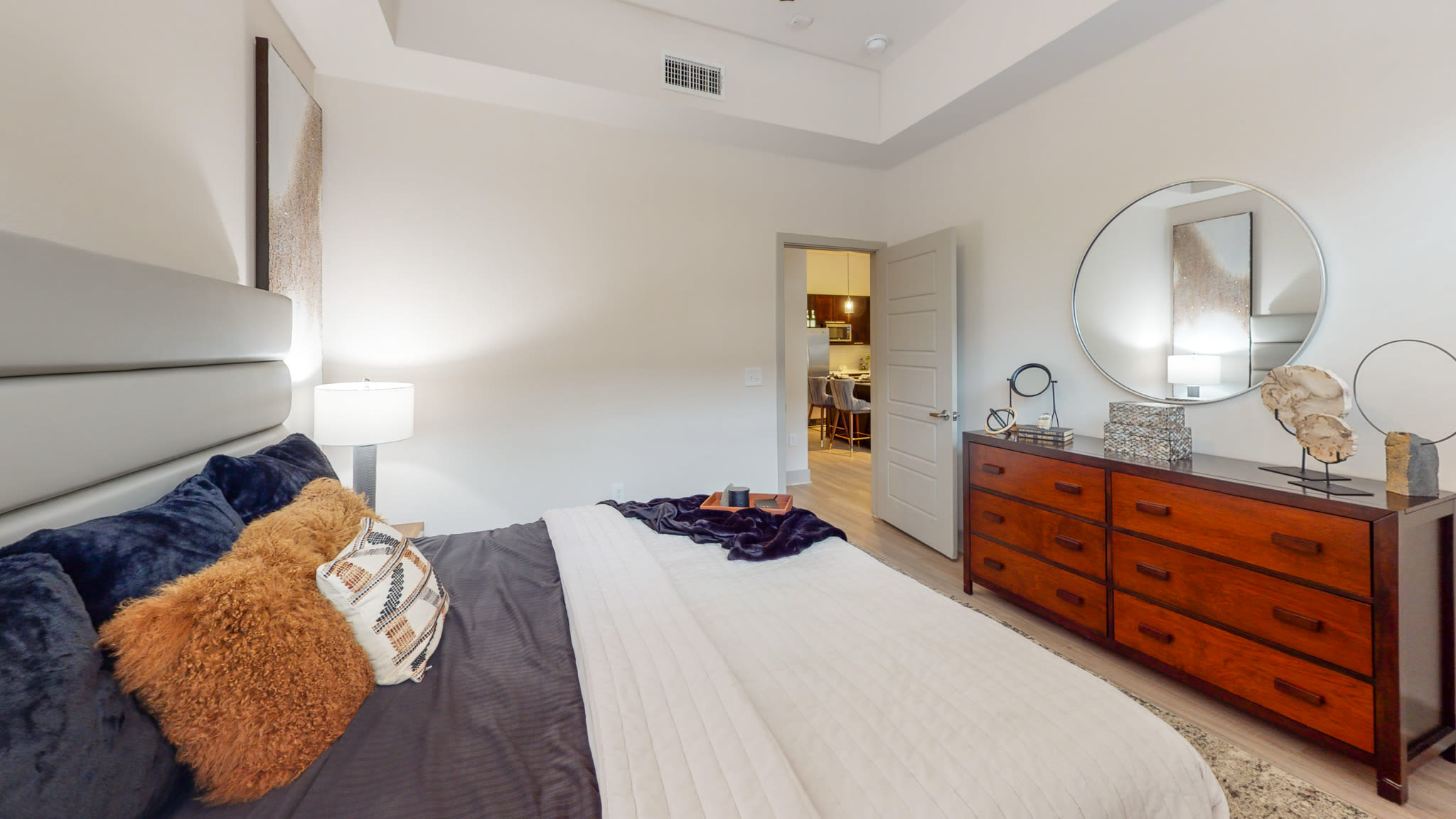 Comfortably furnished bedroom at Bellrock Bishop Arts in Dallas, Texas