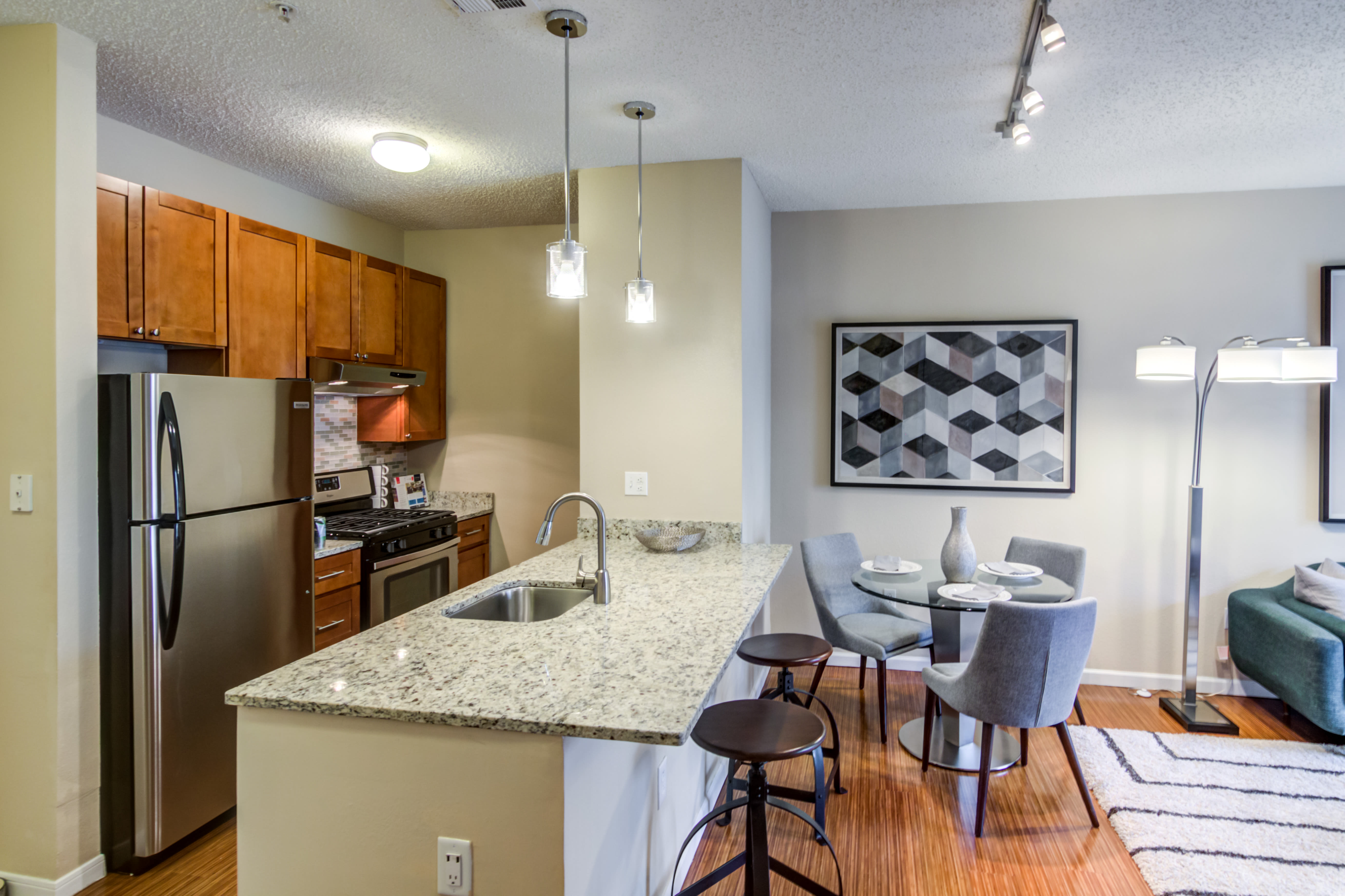 Bright kitchen with a breakfast bar at Sofi Parc Grove in Stamford, Connecticut