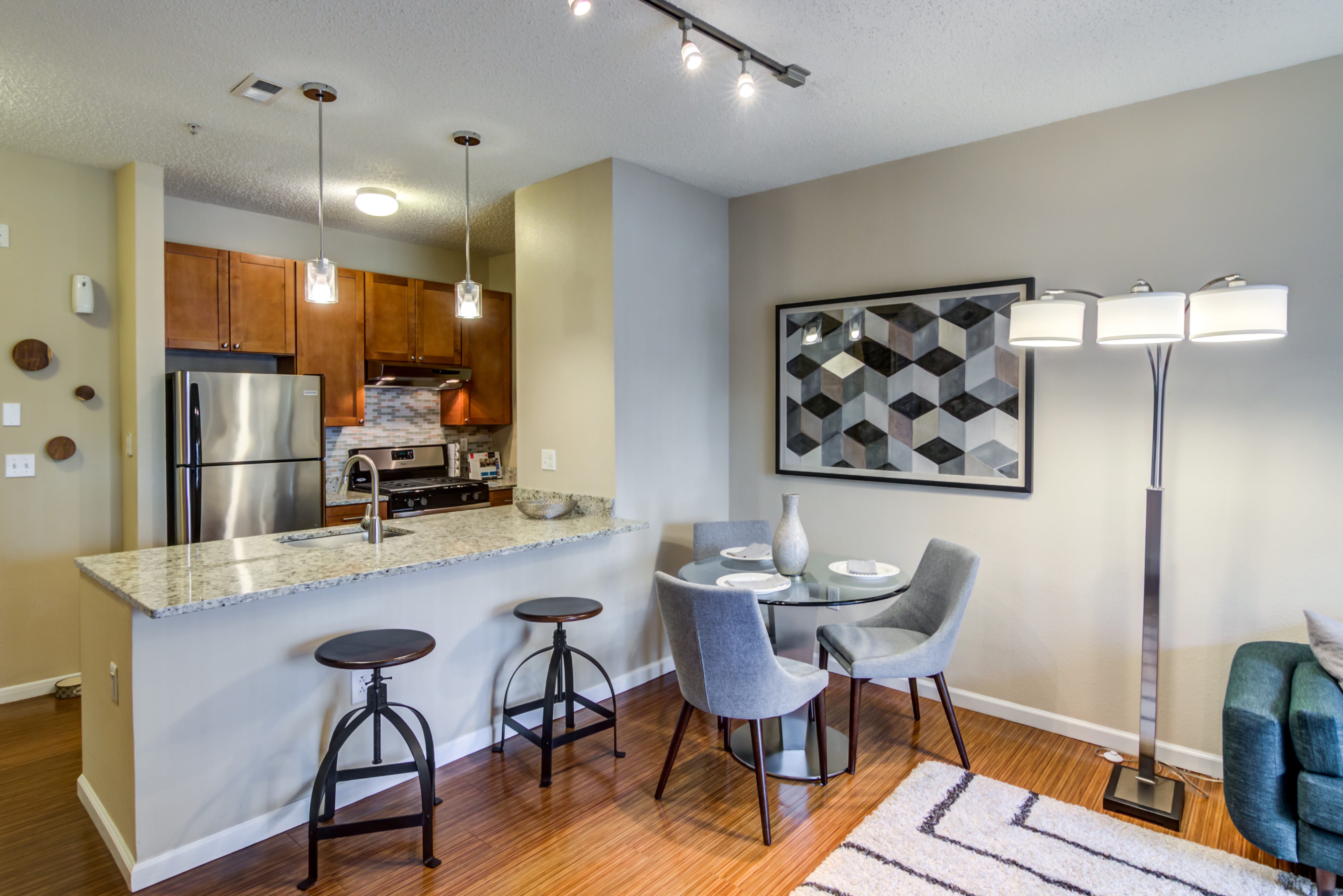 View of the kitchen from the living room at Sofi Parc Grove in Stamford, Connecticut