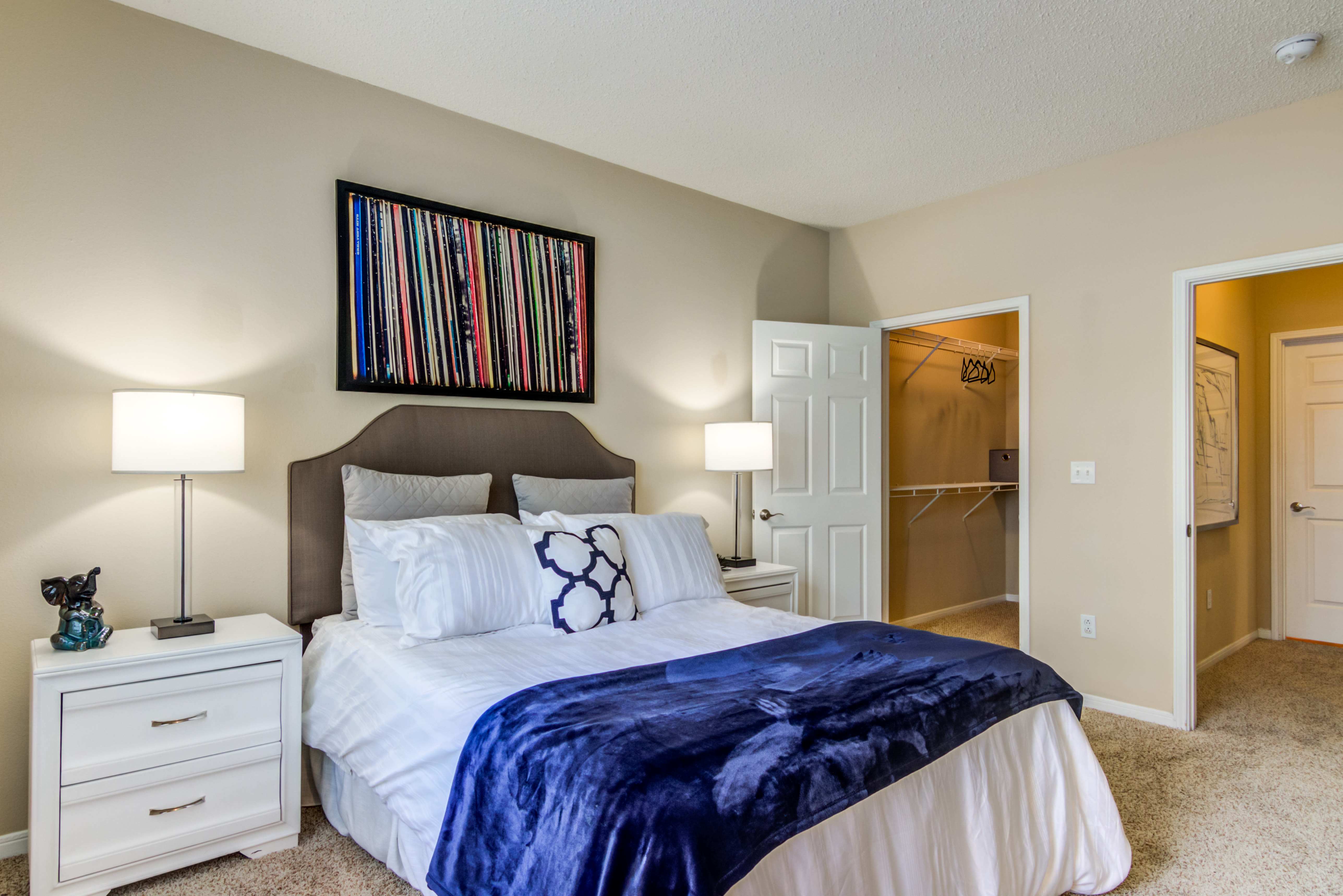 Spacious bedroom with carpet floors at Sofi Parc Grove in Stamford, Connecticut