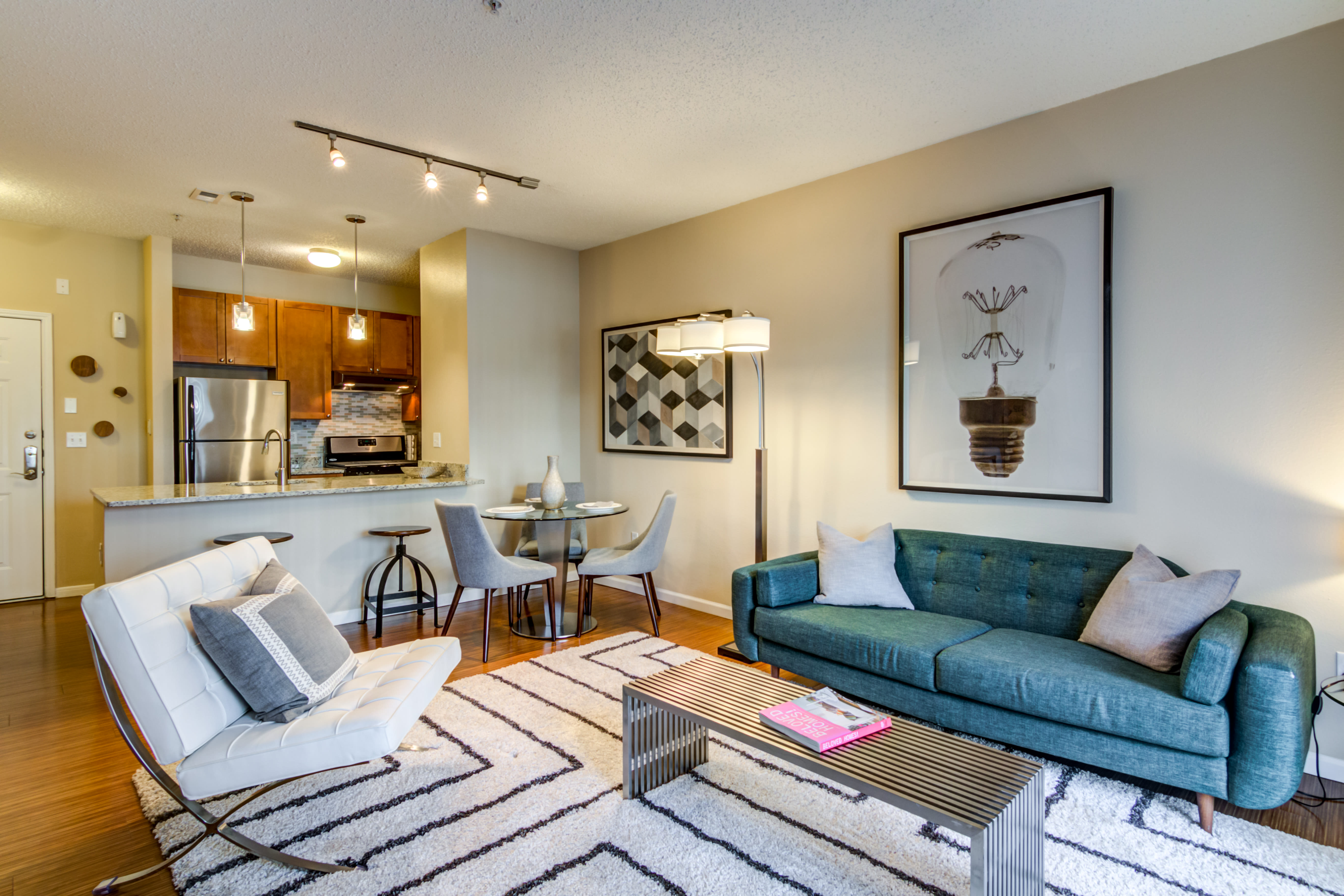 Spacious living room with a large rug at Sofi Parc Grove in Stamford, Connecticut