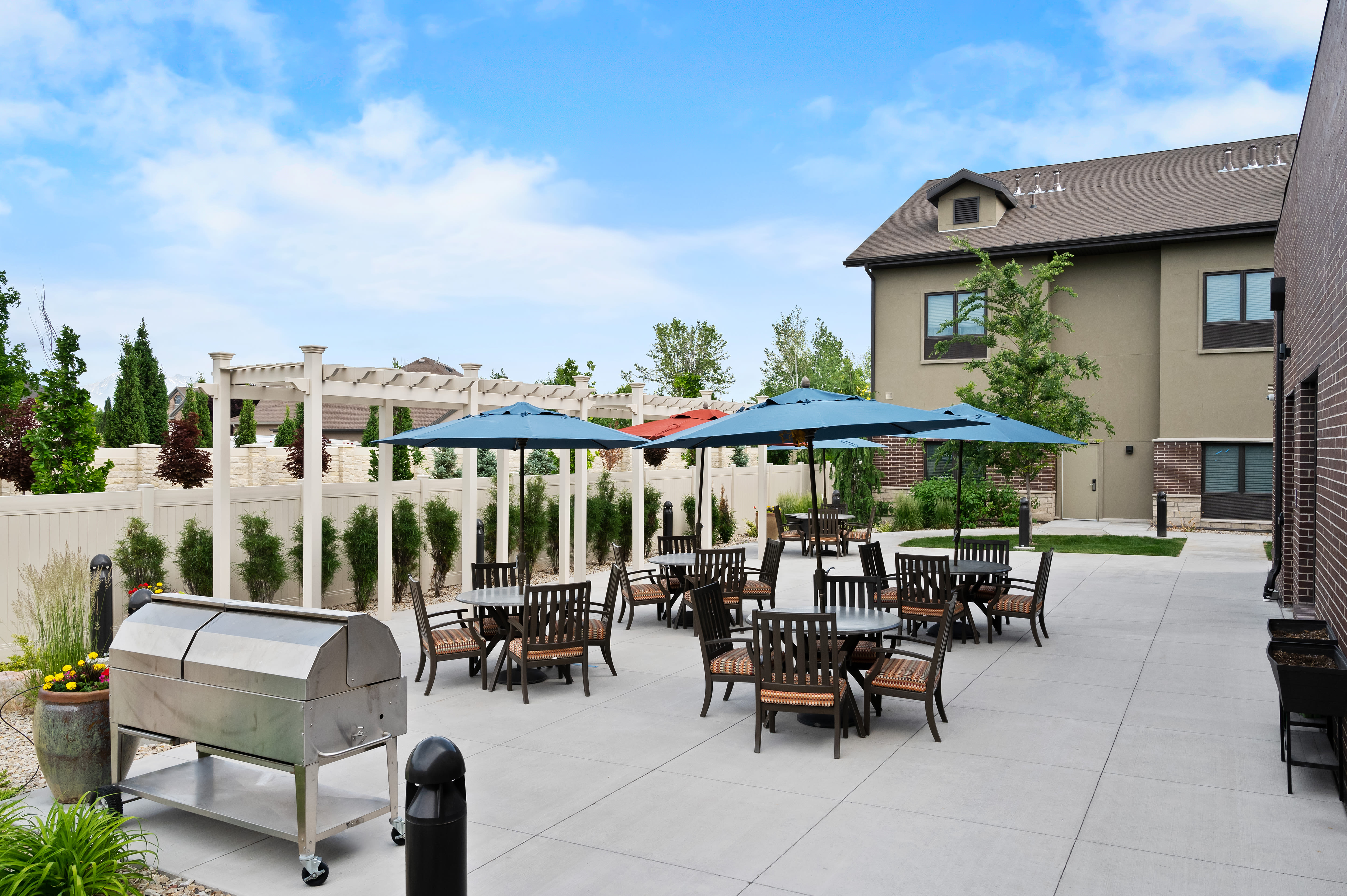 exterior patio seating with BBQ