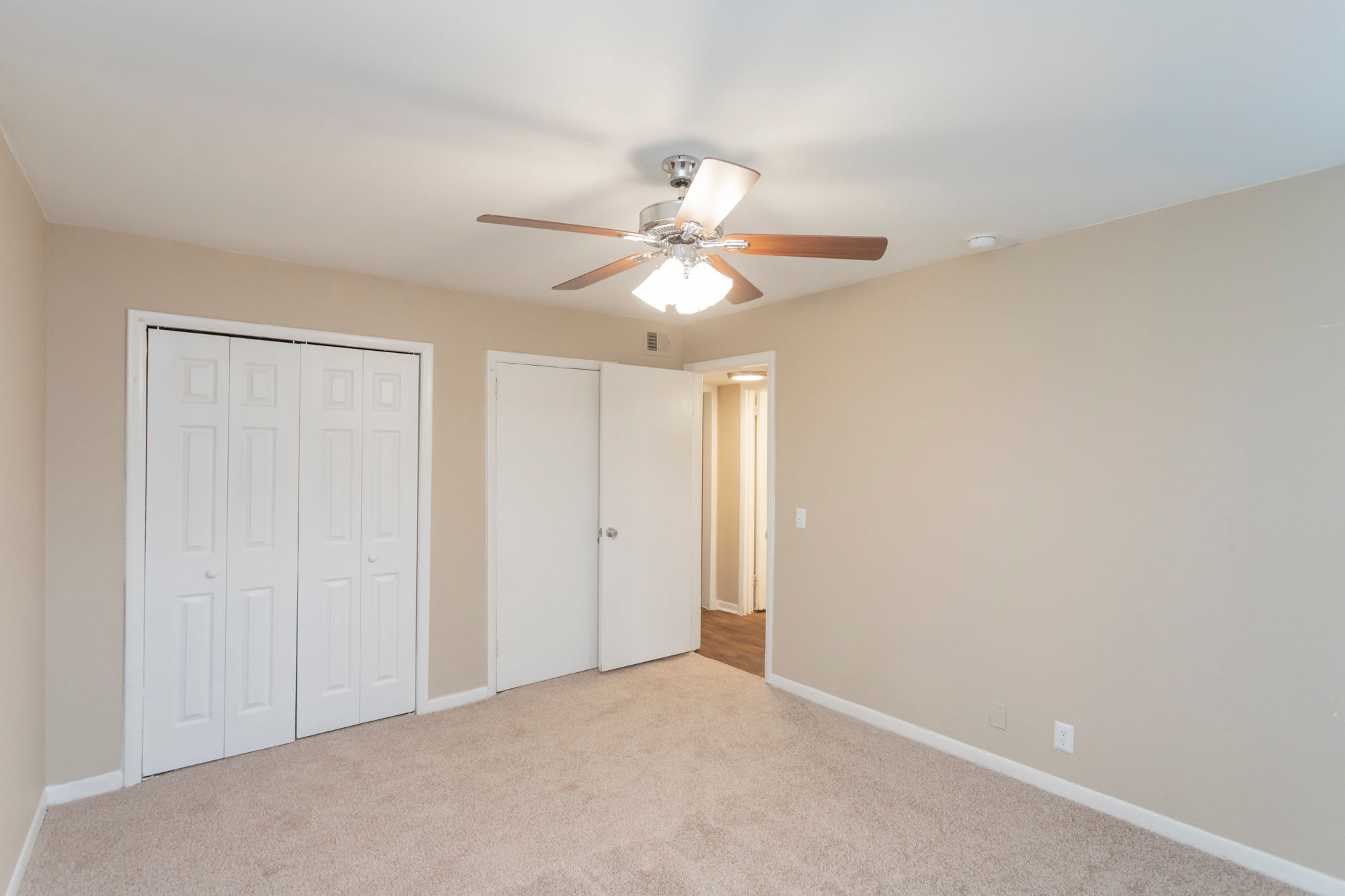 Bedroom and closets with ceiling fan at Maple Creek in Nashville, Tennessee