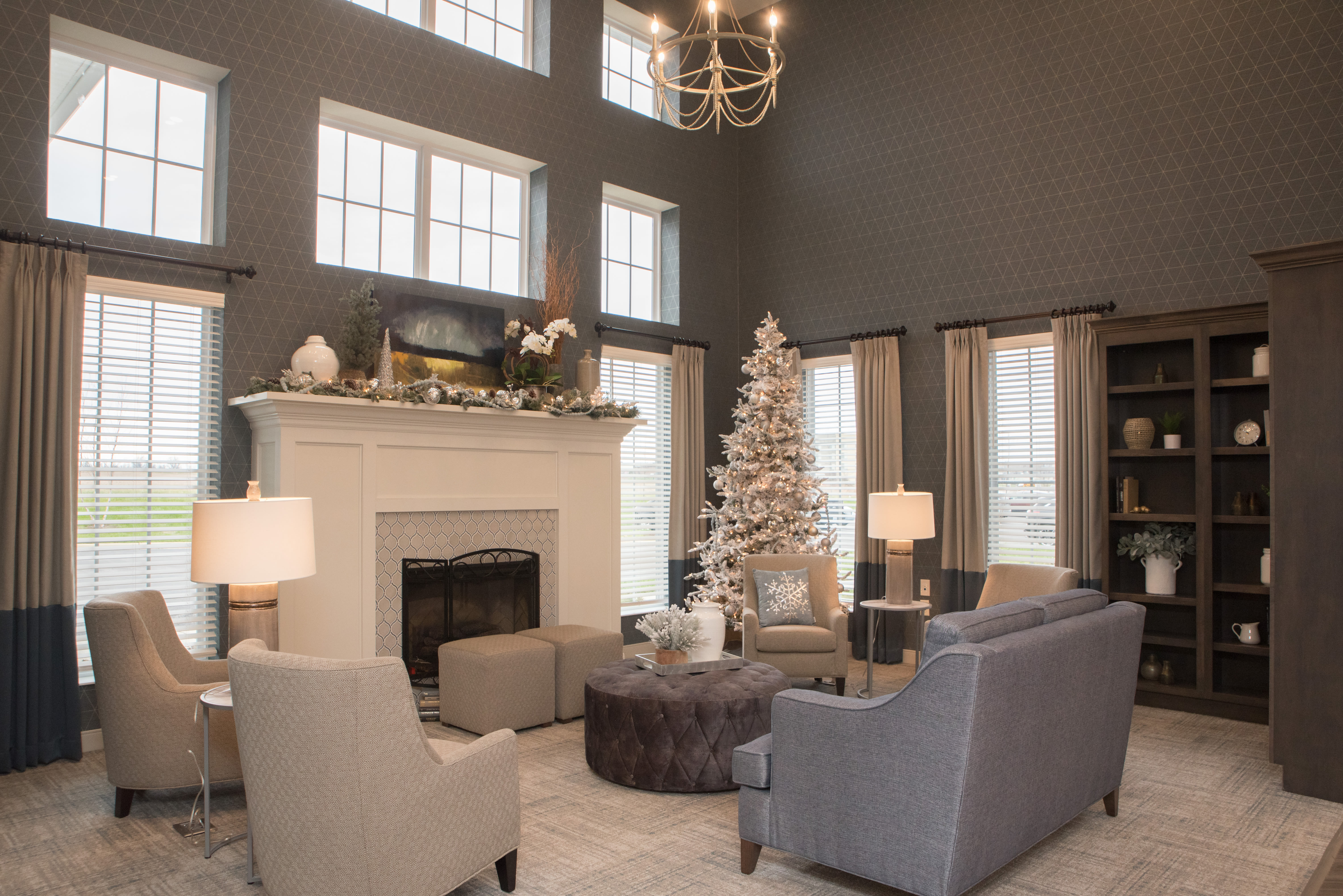 Fireplace and comfy chairs at Cooper Trail Senior Living in Bardstown, Kentucky