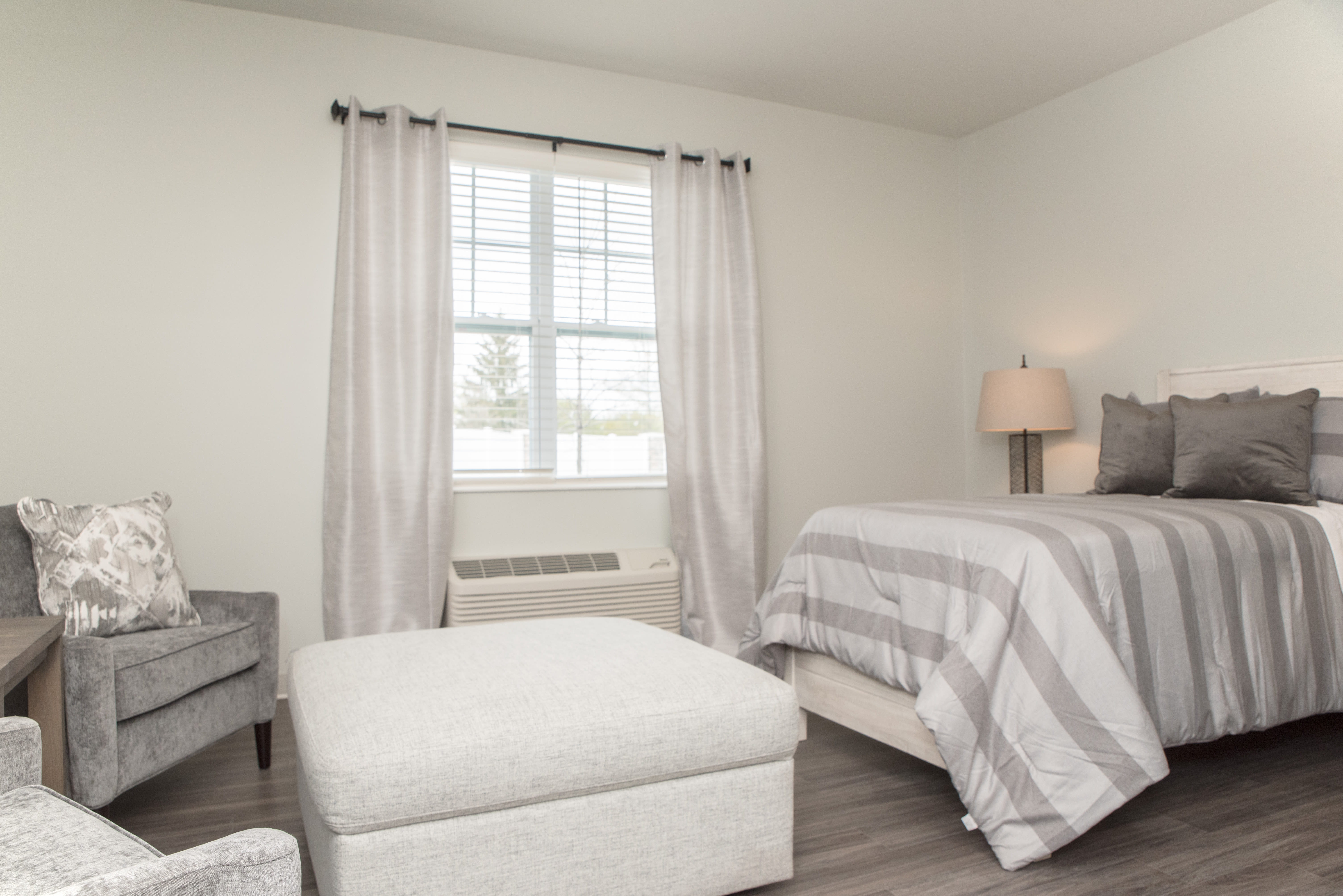 Bedroom with window at Cooper Trail Senior Living in Bardstown, Kentucky