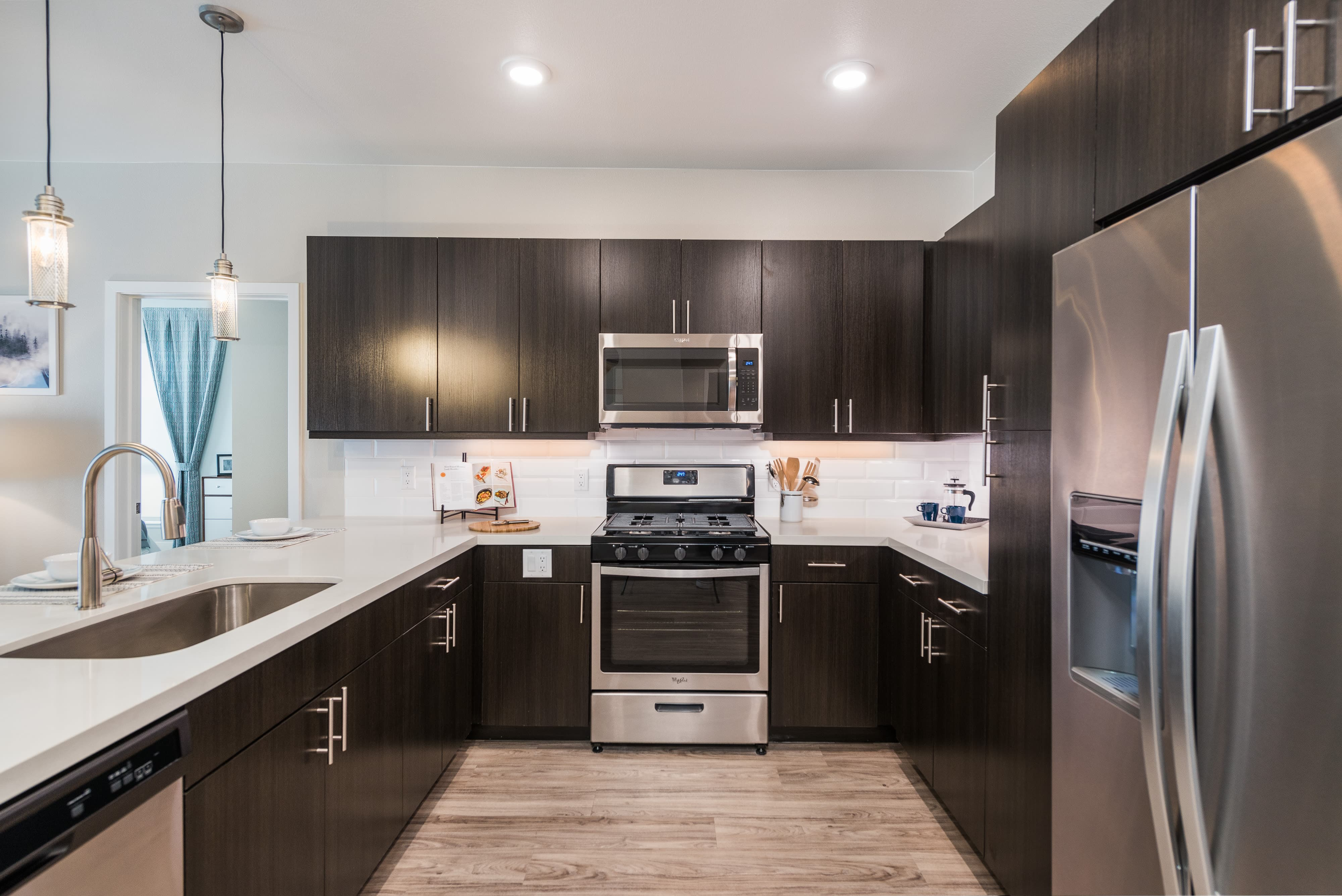 Quartz countertops with stainless steel appliances in Colorado.