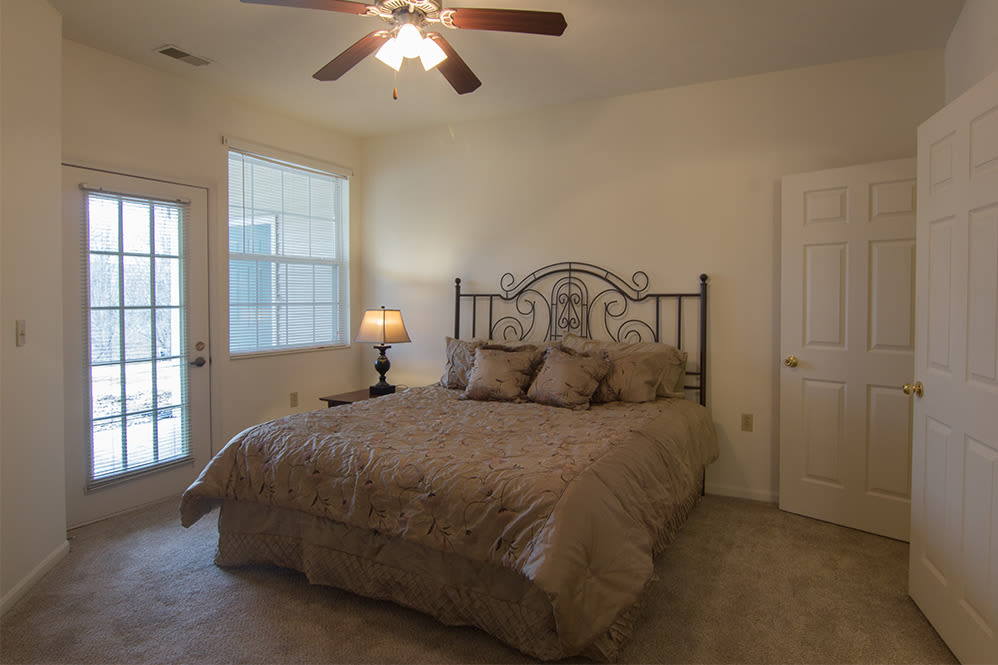 Cozy bedroom at Hills of Aberdeen Apartment Homes in Valparaiso, Indiana