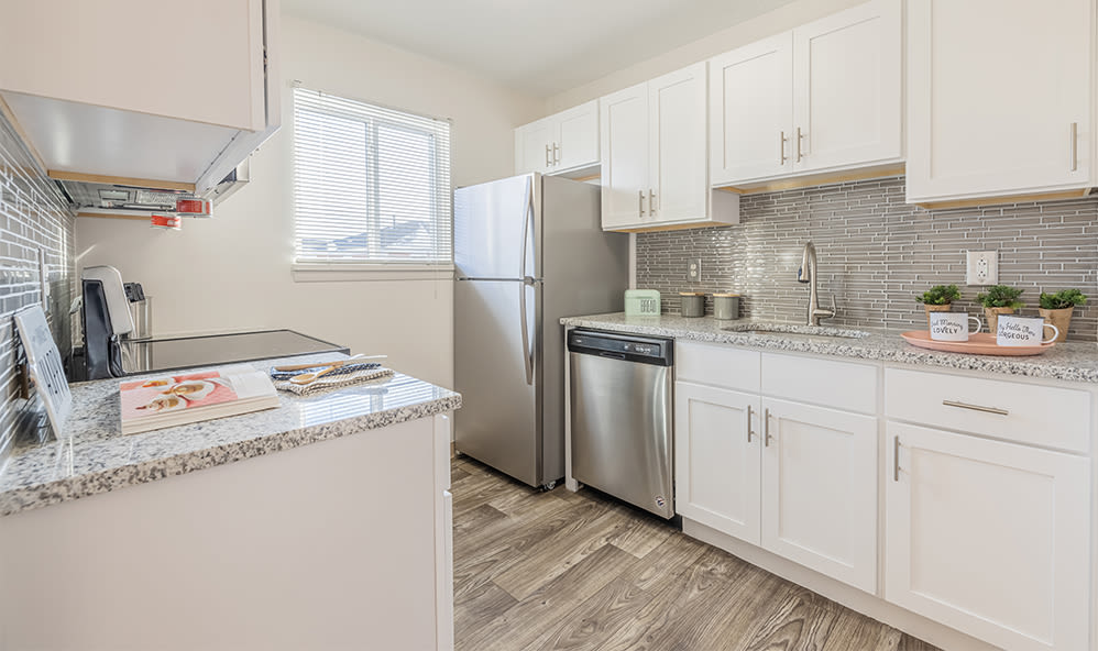 Fully-equipped kitchen at Waverlywood Apartments & Townhomes in Webster, New York
