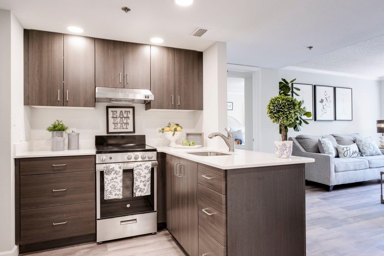 Kitchen and living room at Grand Villa of Sarasota